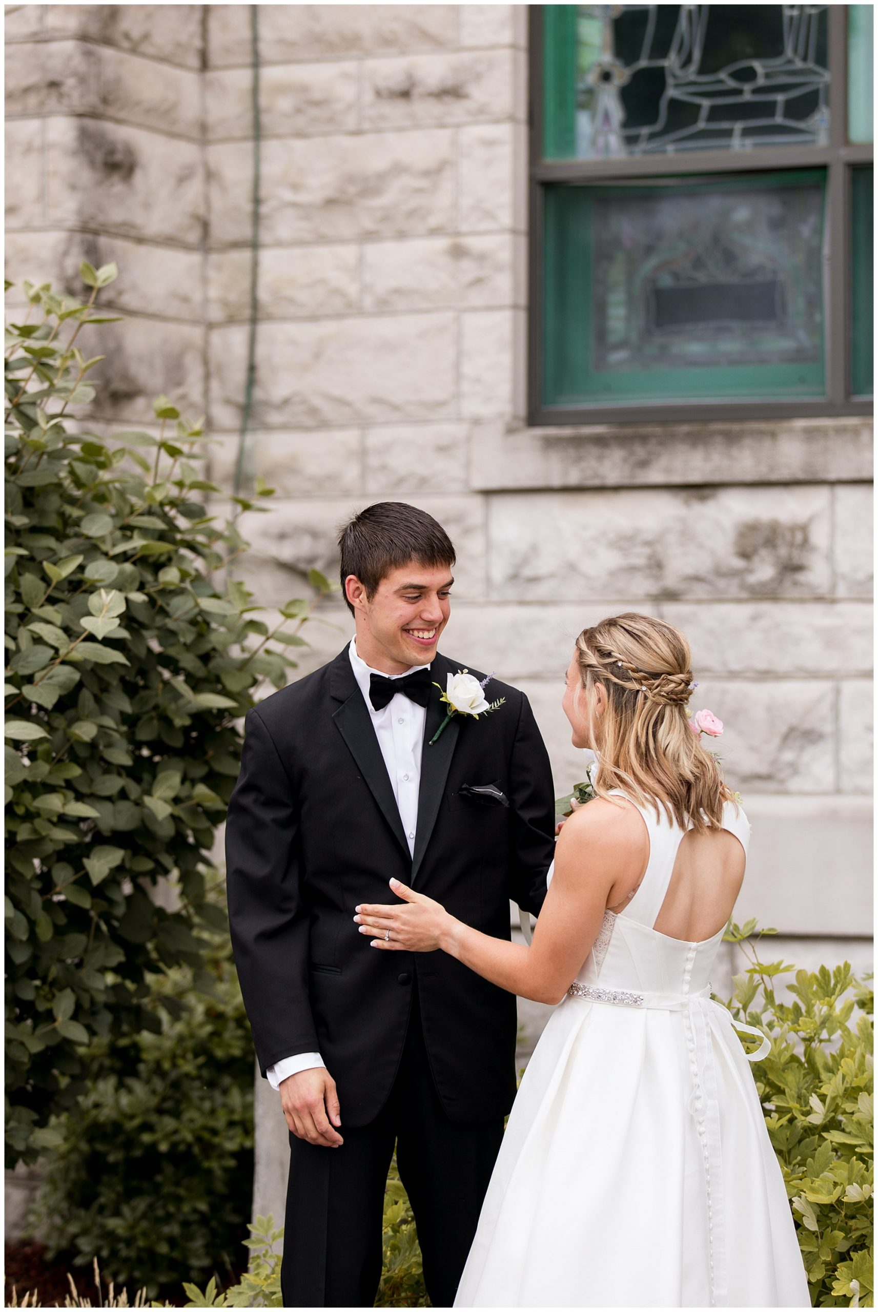 bride and groom first look in rosary garden at St. Patrick Church in Kokomo Indiana