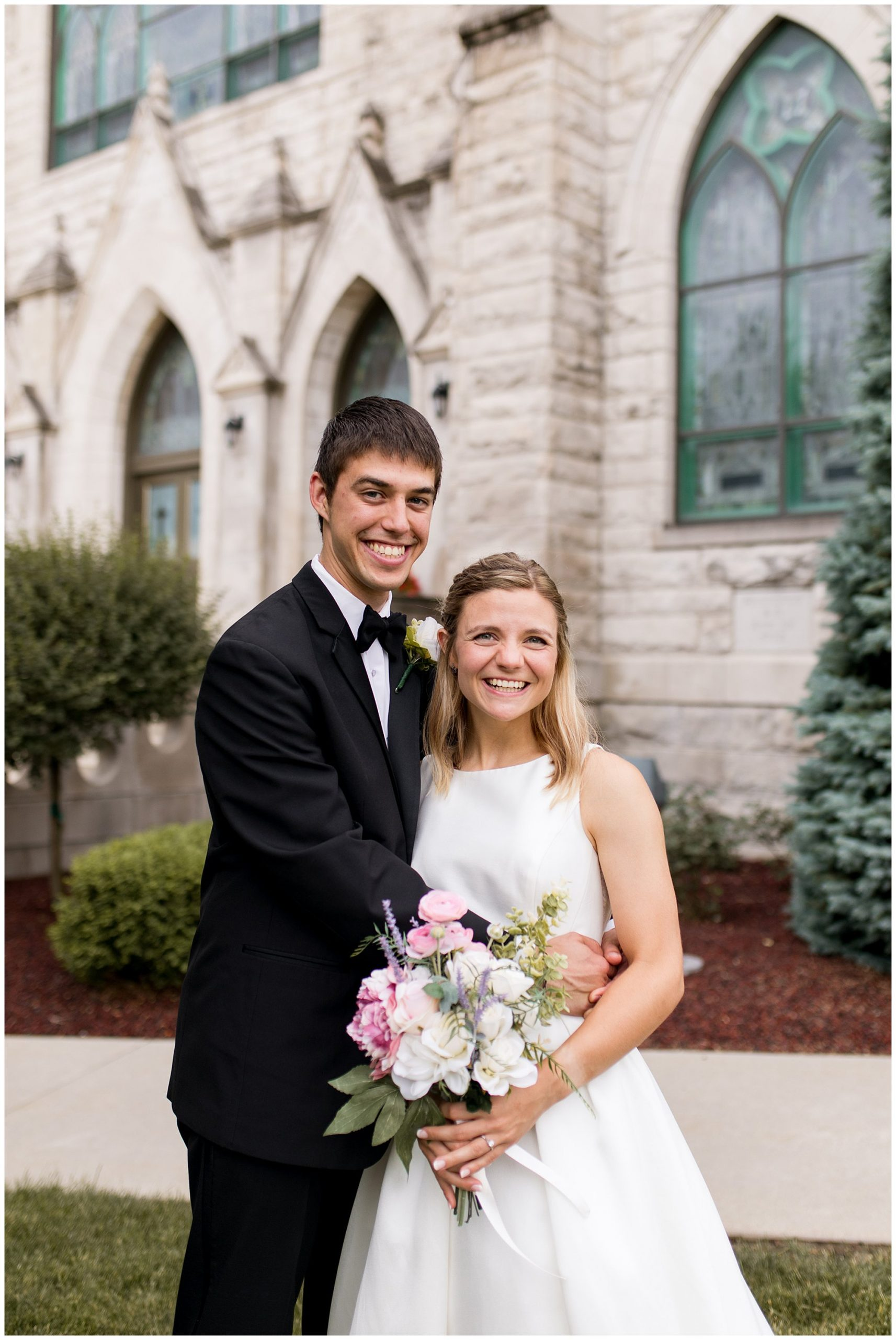 bride and groom in front of St. Patrick Church in Kokomo Indiana