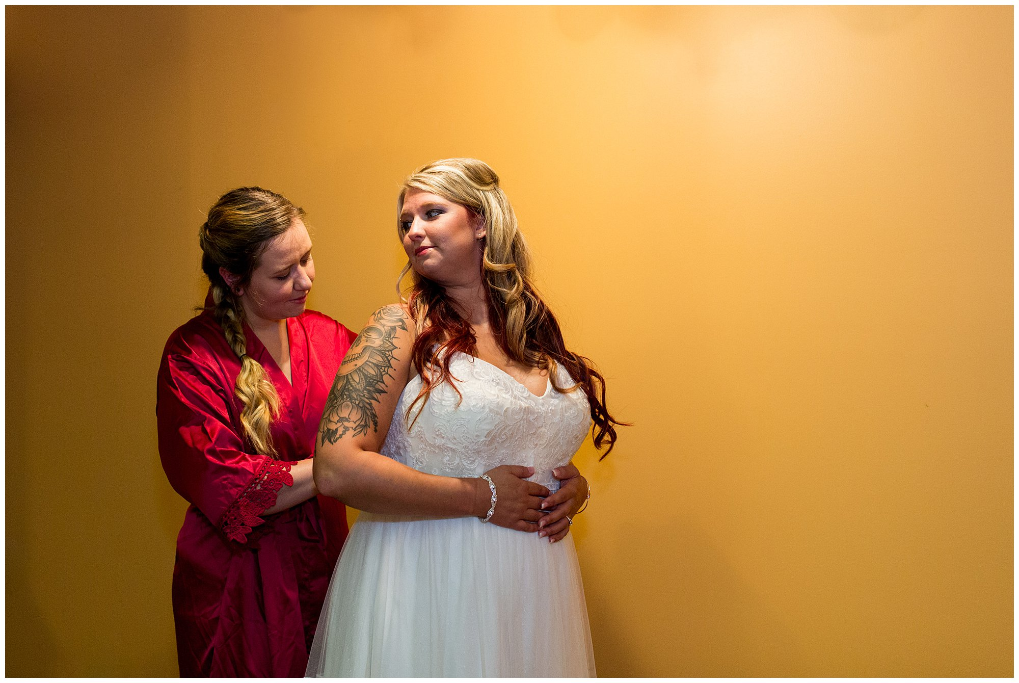 bride getting into dress at The Old Mill Village in Fremont Indiana