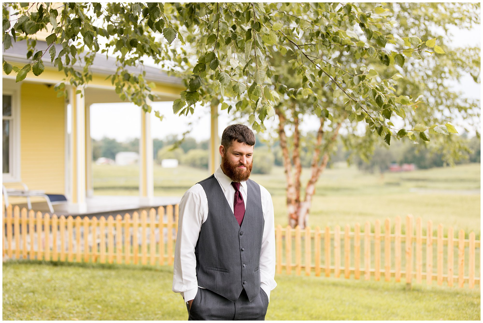 groom waiting for bride during first look at The Old Mill Village wedding in Fremont Indiana