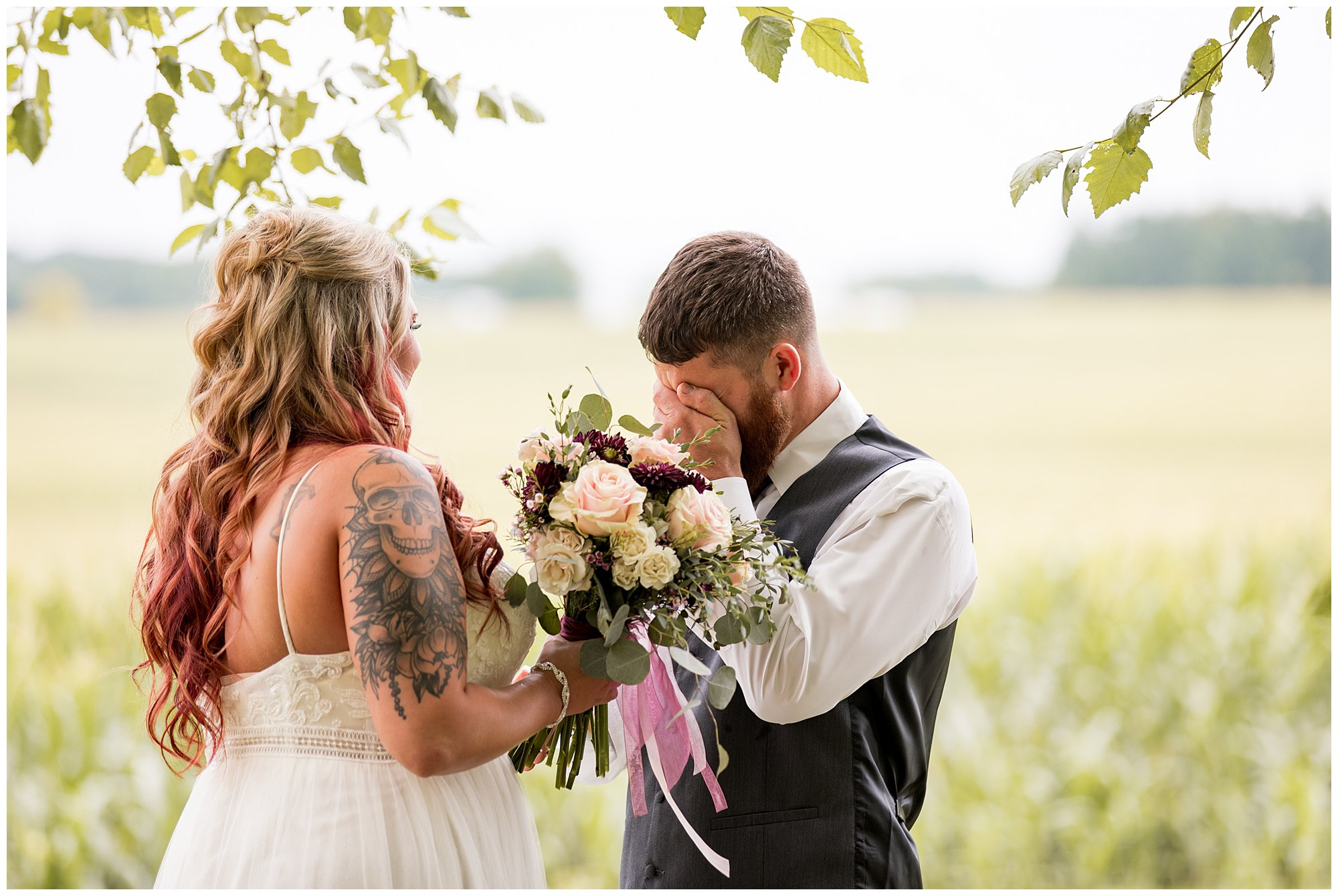 groom crying during first look at The Old Mill Village in Fremont Indiana