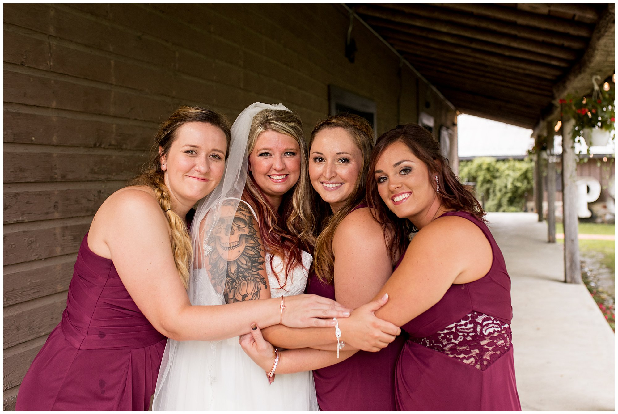 bride and bridesmaids before wedding ceremony at The Old Mill Village in Fremont Indiana