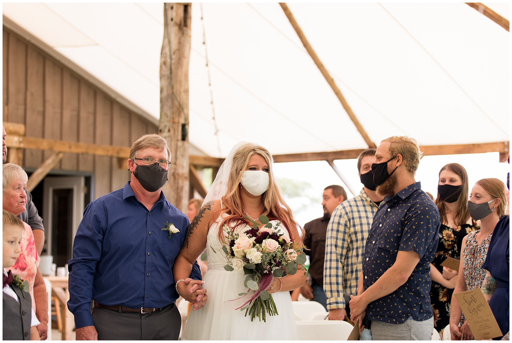 bride walks down aisle during wedding at The Old Mill Village in Fremont Indiana