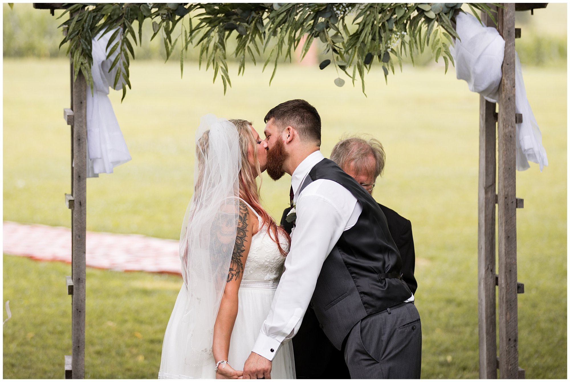 bride and groom kiss during Fremont Indiana wedding