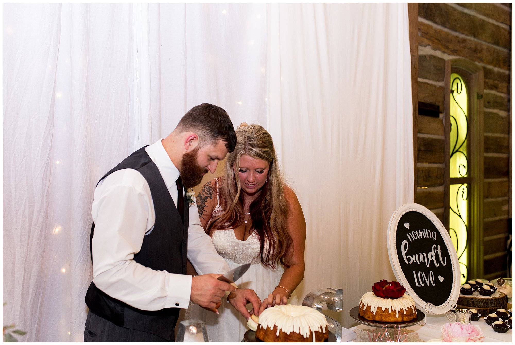 bride and groom cut wedding cake at The Old Mill Village