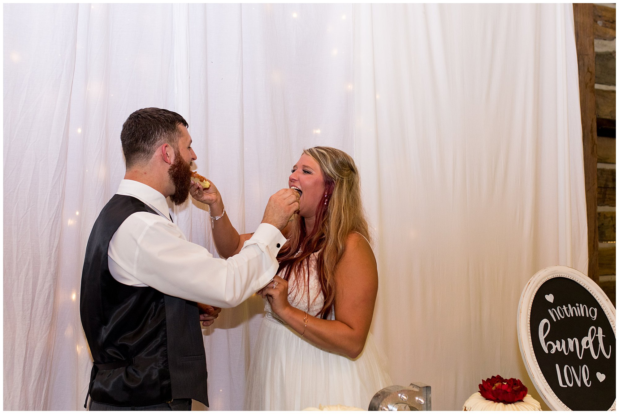 bride and groom feed each other wedding cake at The Old Mill Village
