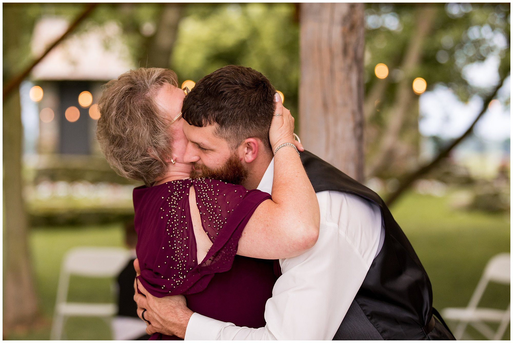 groom dances with mom at The Old Mill Vilage WEdding