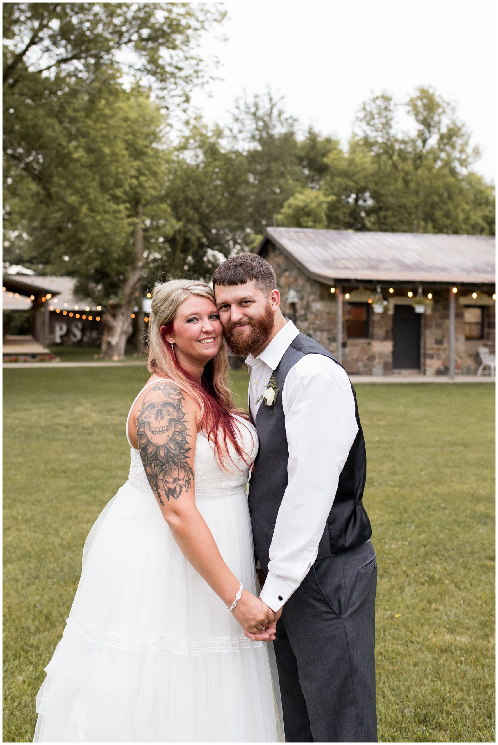 bride and groom portraits at The Old Mill Village at Fremont, Indiana