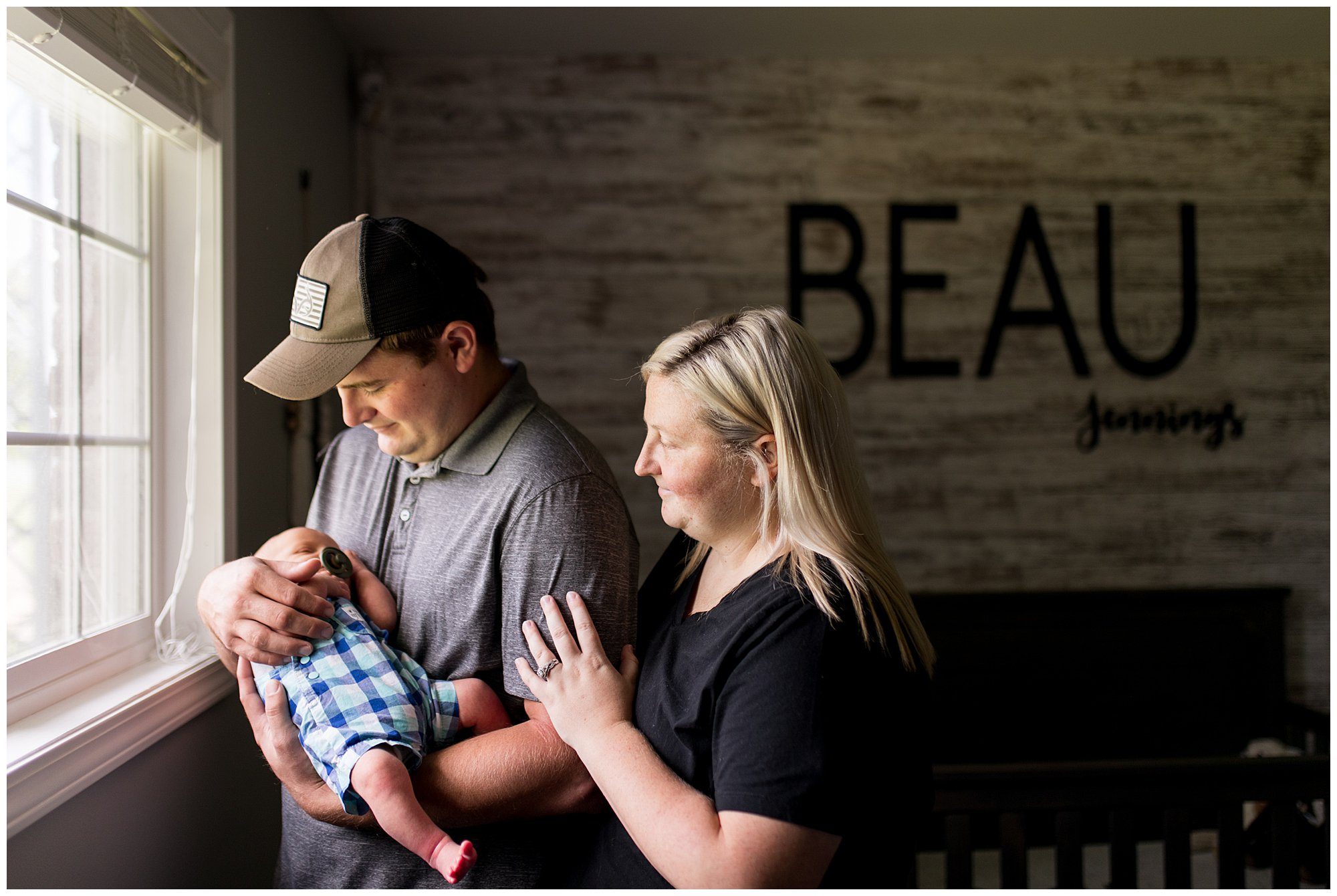 mom and dad hold baby during Muncie newborn session