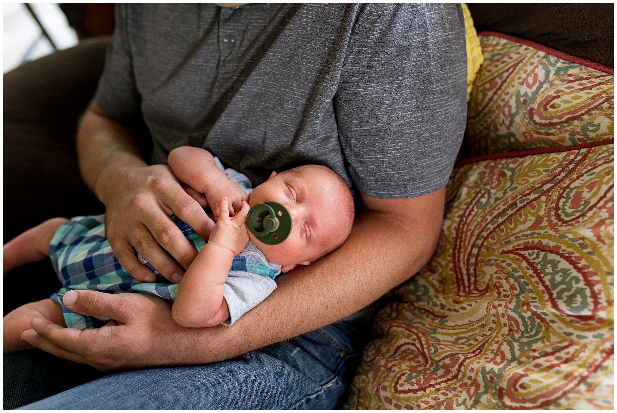 dad holds baby during Muncie newborn session
