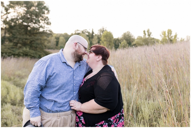 couple snuggles during engagement session at Fort Harrison State Park in Indianapolis