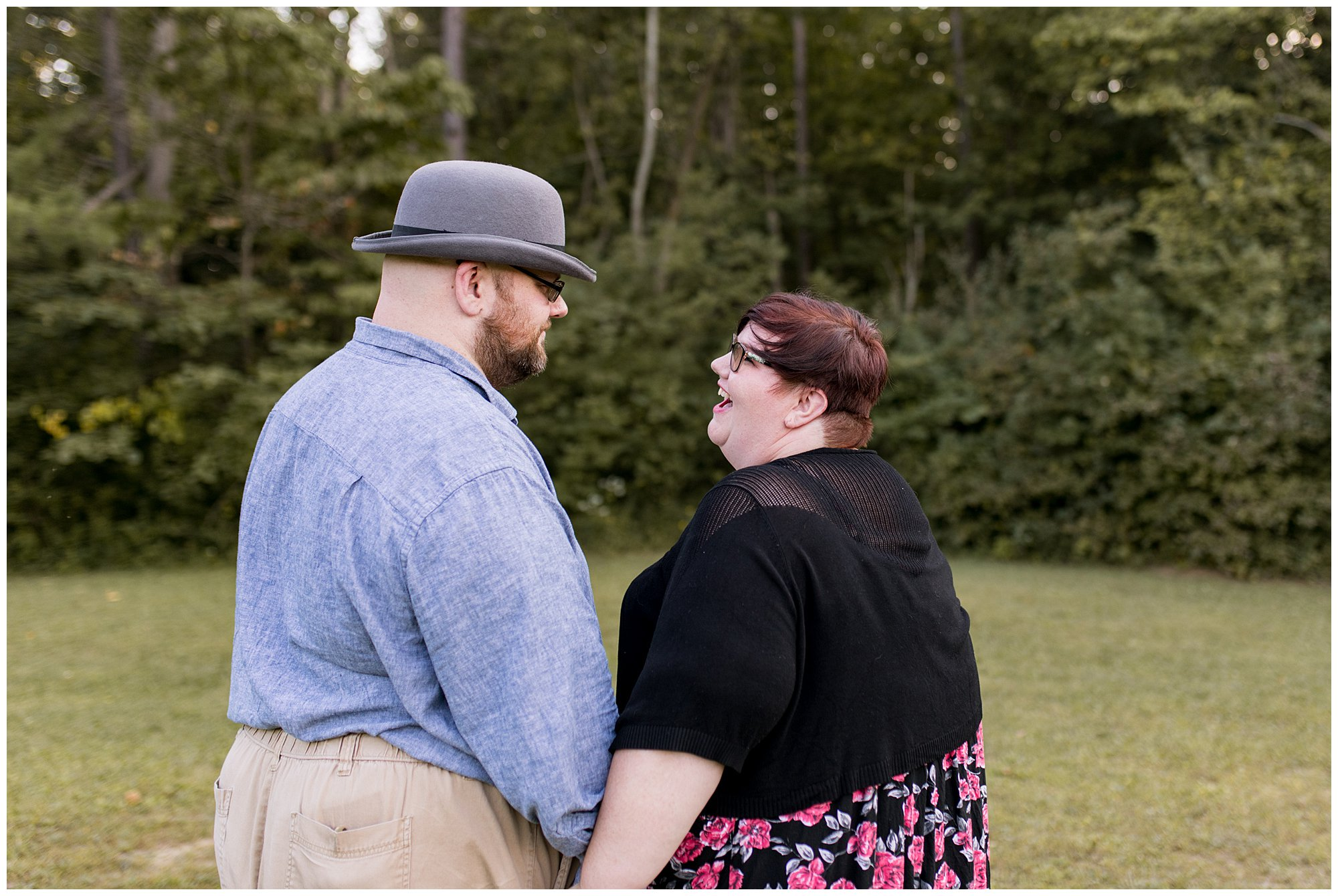 couple holds hand during Fort Harrison State Park engagement session in Indianapolis