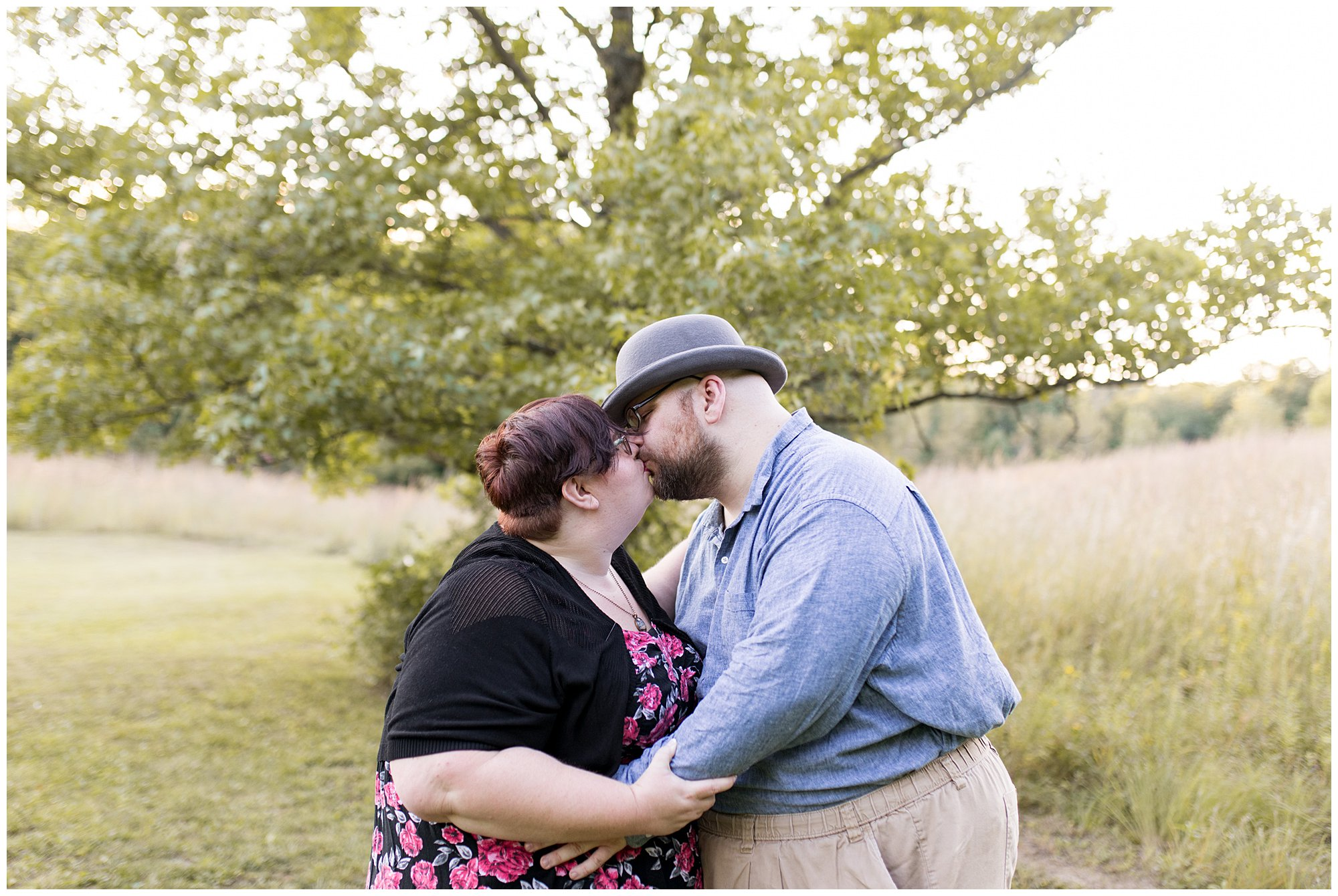 couple kisses during Indianapolis engagement session at Fort Harrison State Park