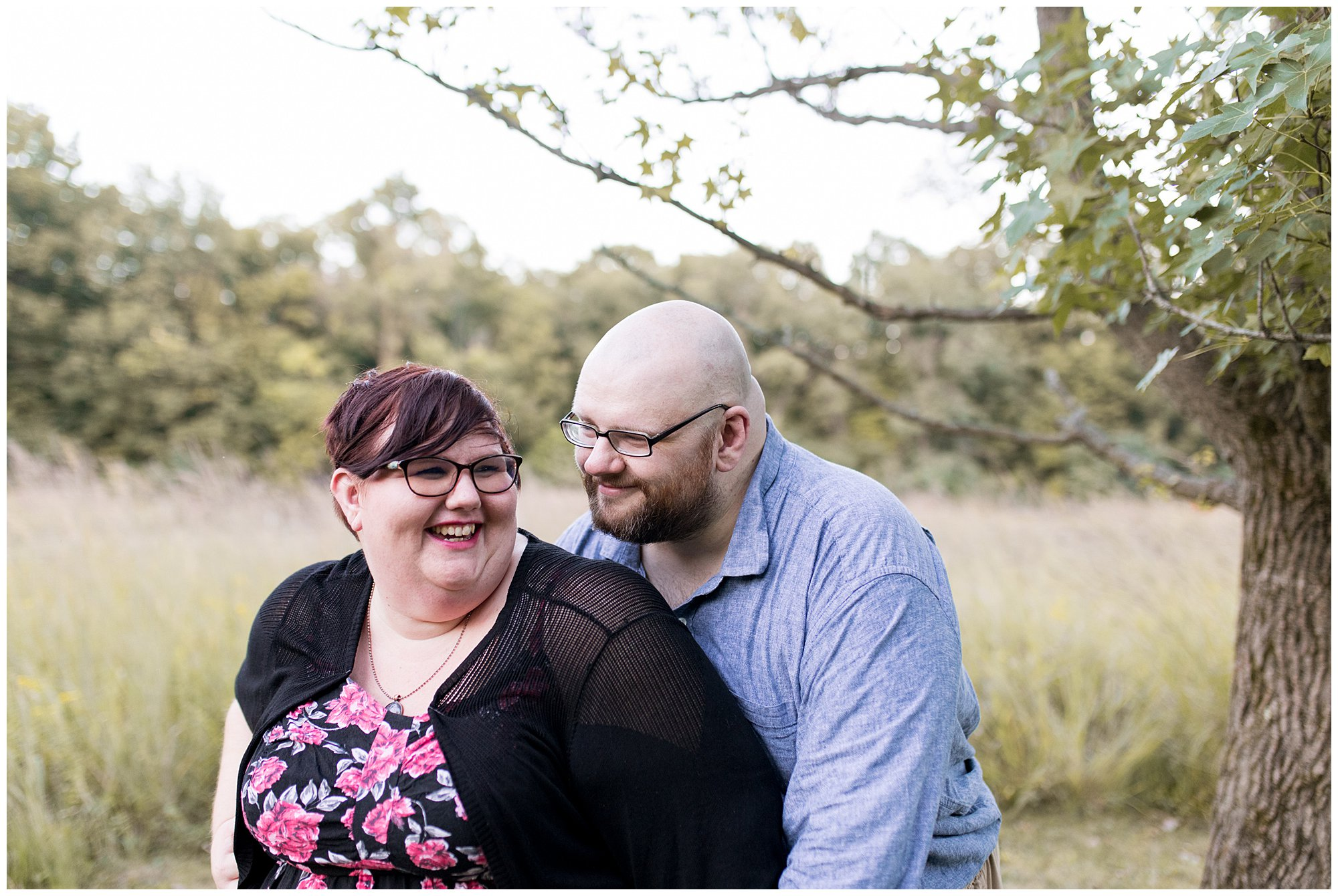 bride and groom laugh together during Indianapolis engagement session at Fort Harrison State Park