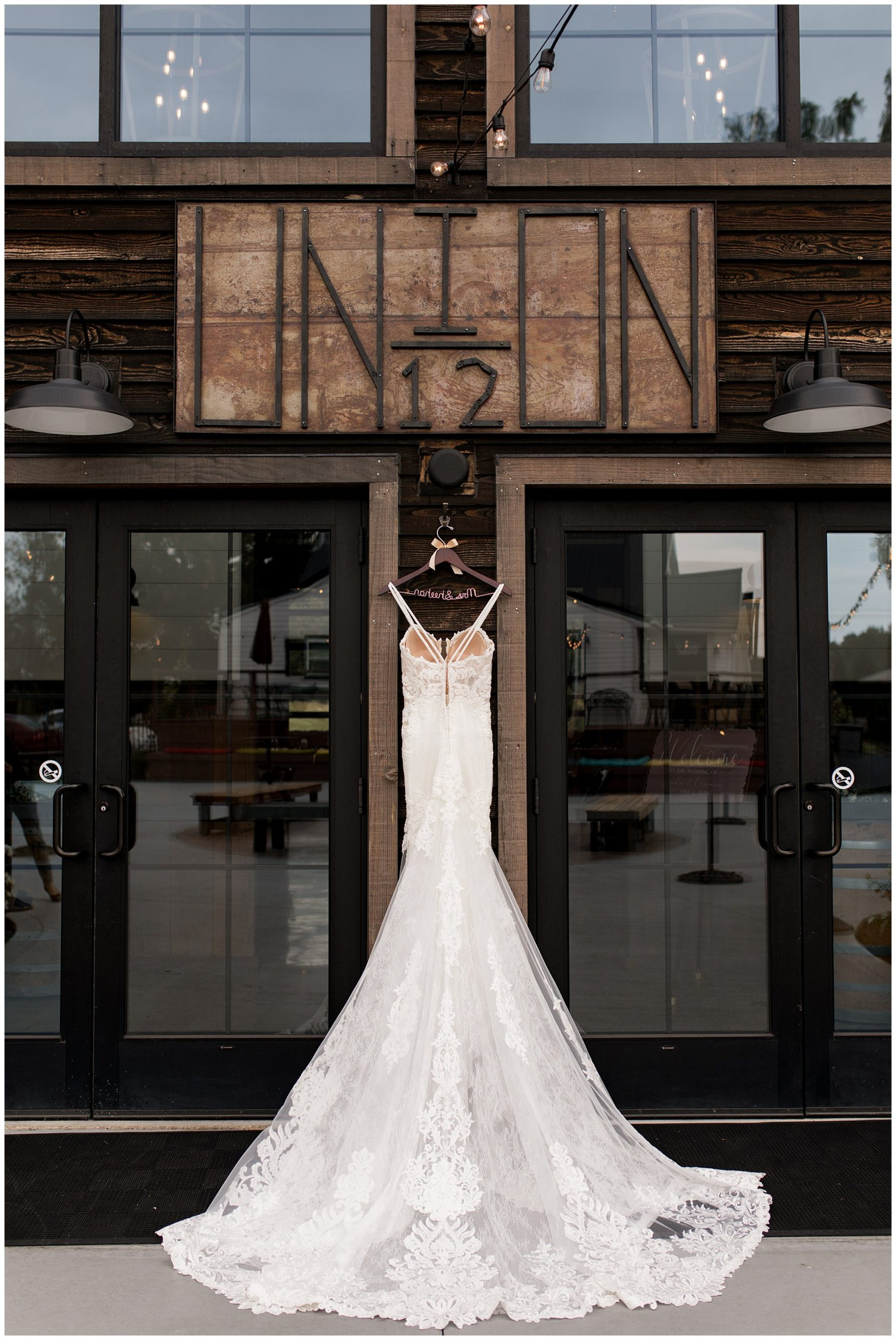 bride's wedding dress under sign at Union 12