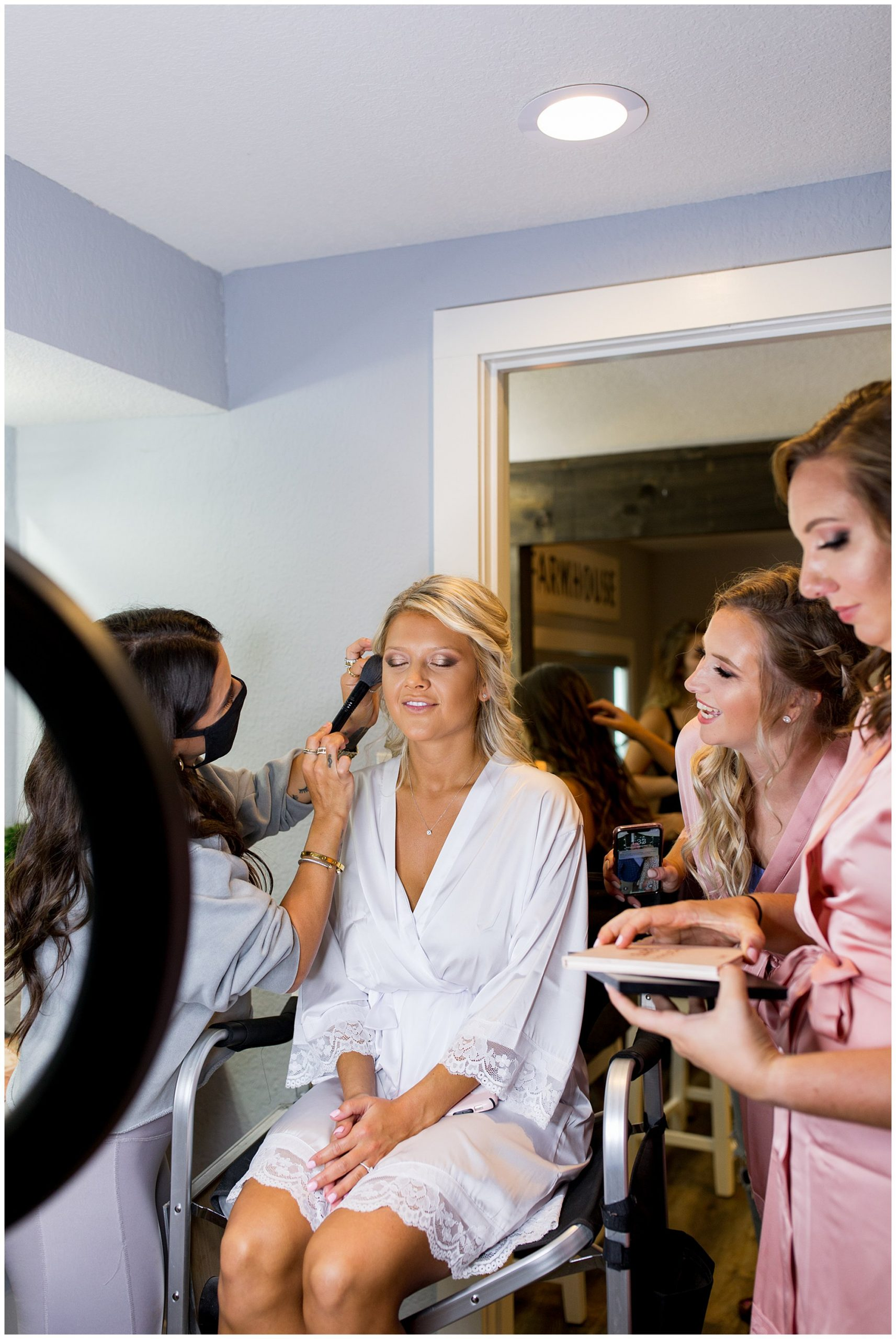 bride having makeup done at Union 12 wedding venue in Columbia City, Indiana