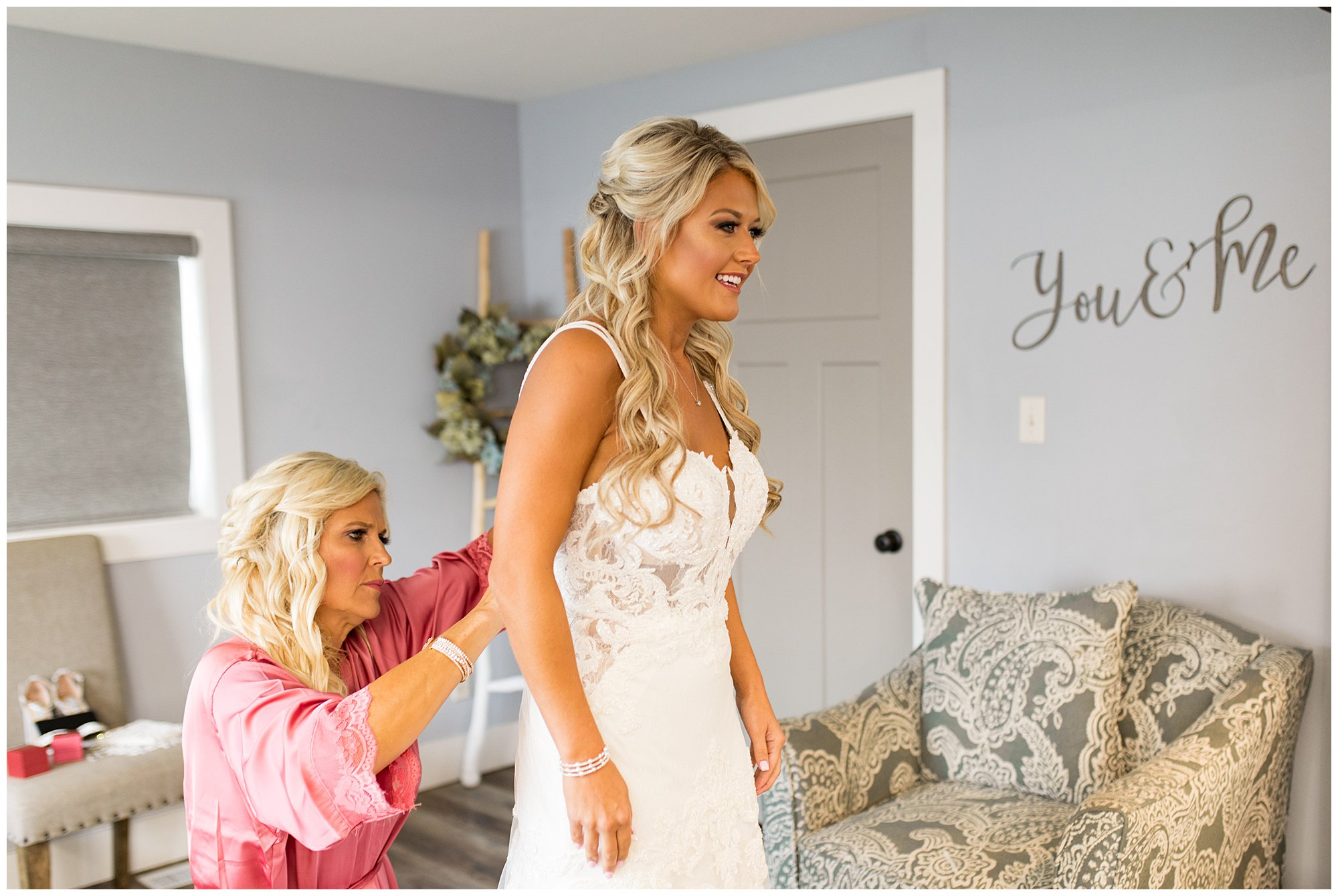 bride gets into dress before Fort Wayne wedding at Union 12