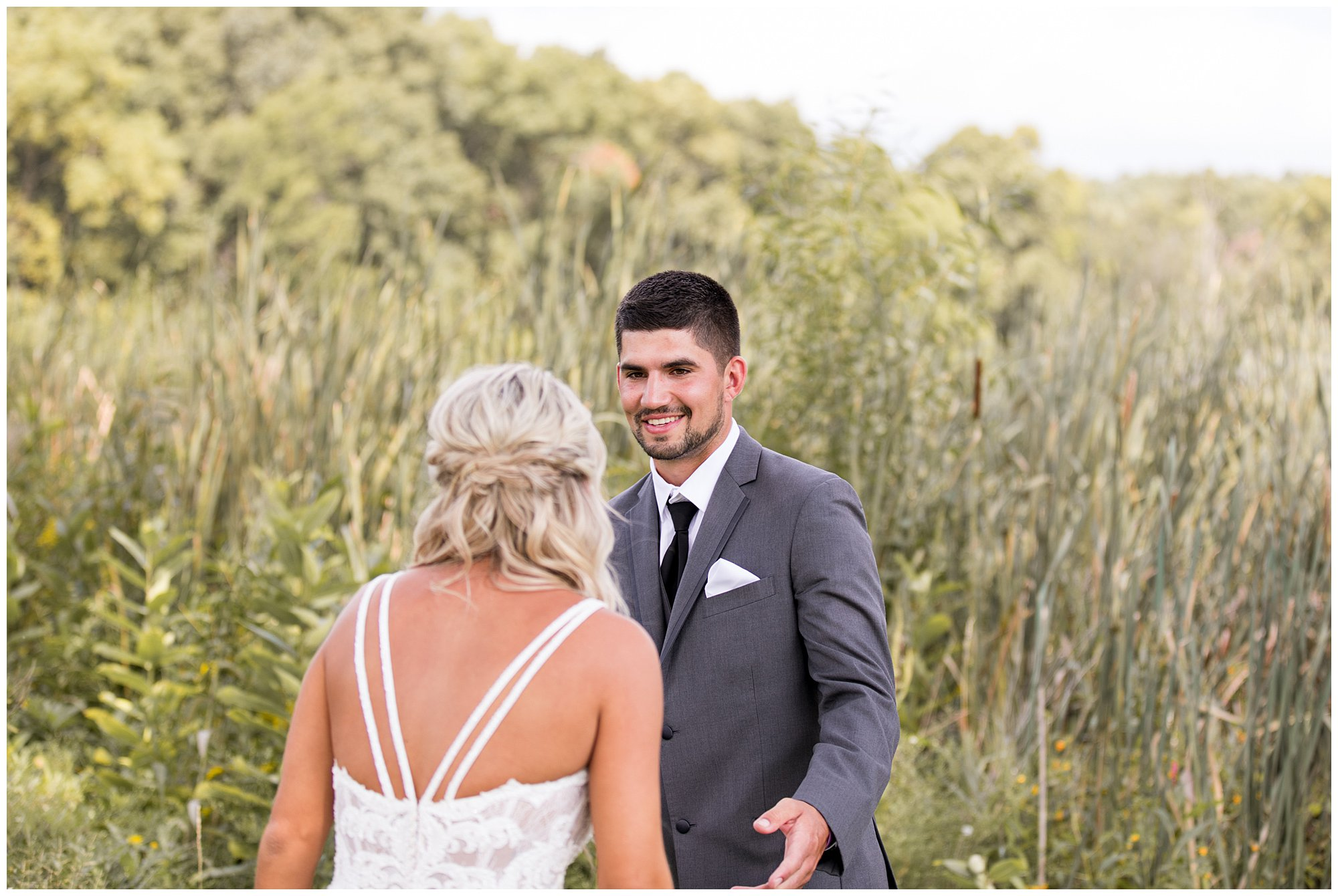 first look with bride and groom at Union 12 wedding venue in Fort Wayne