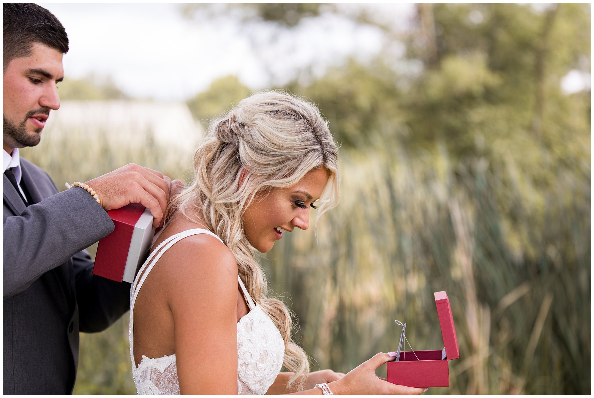 groom presents bride with gift during first look at Union 12 wedding venue