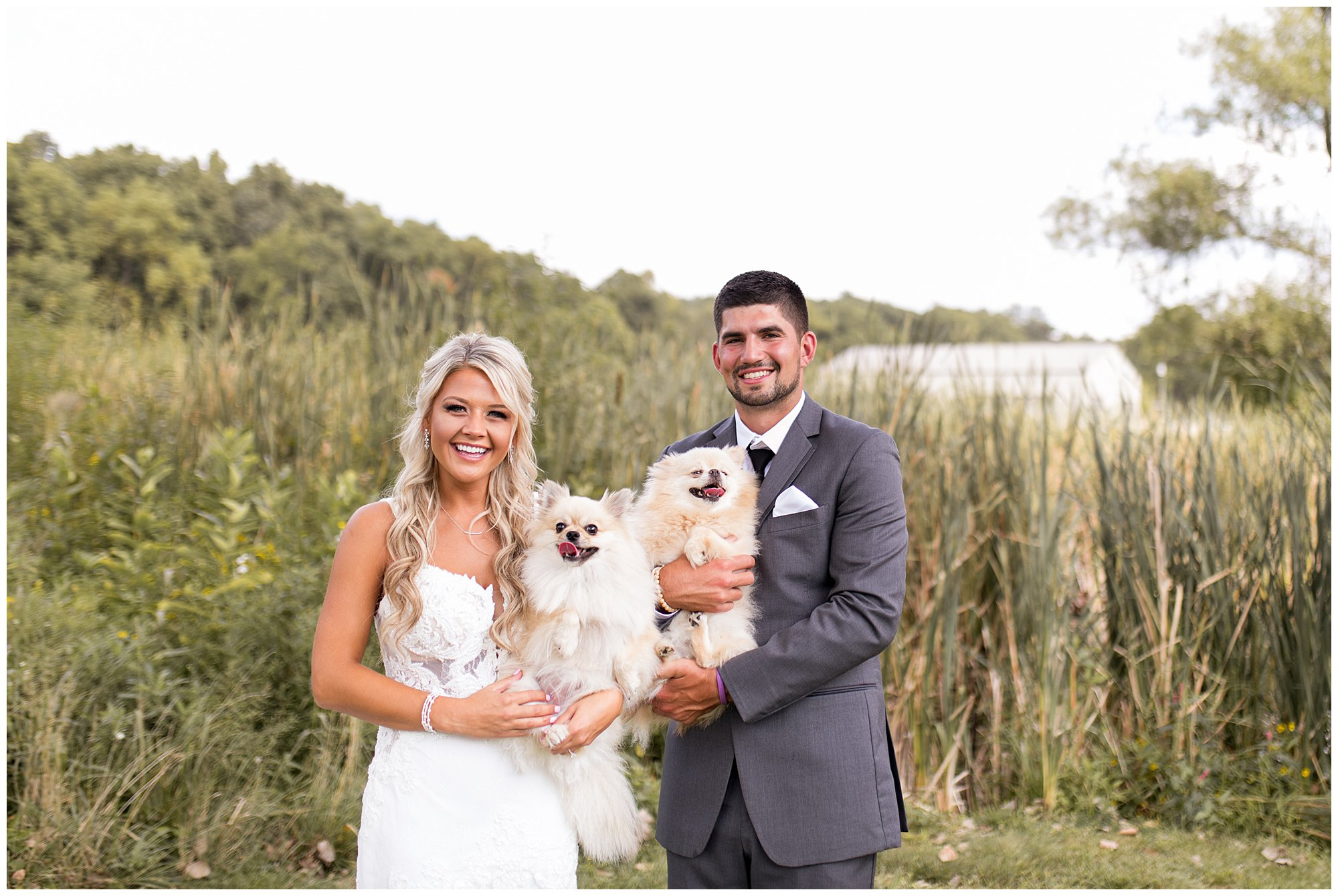 bride and groom hold their dogs on their wedding day at Union 12