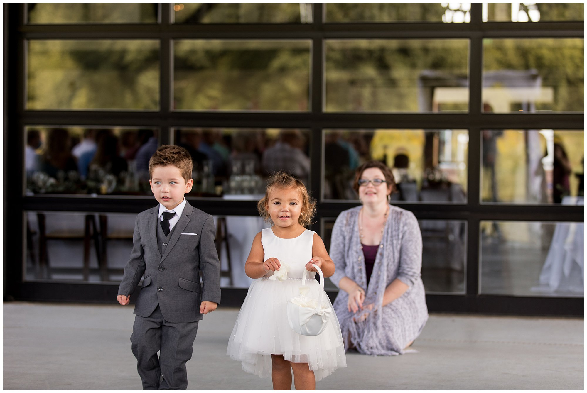 ring bearer and flower girl walk down aisle at Union 12 before ceremony