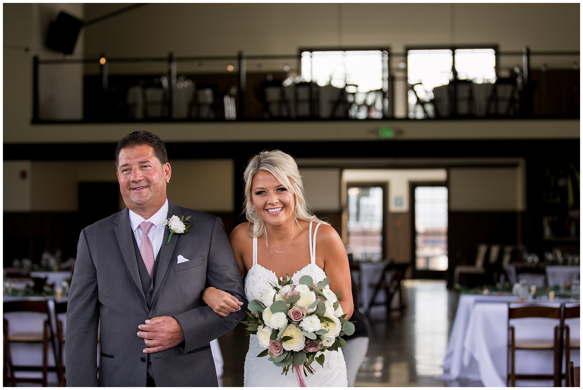 bride and father laugh together as they walk down aisle at Union 12 in Fort Wayne