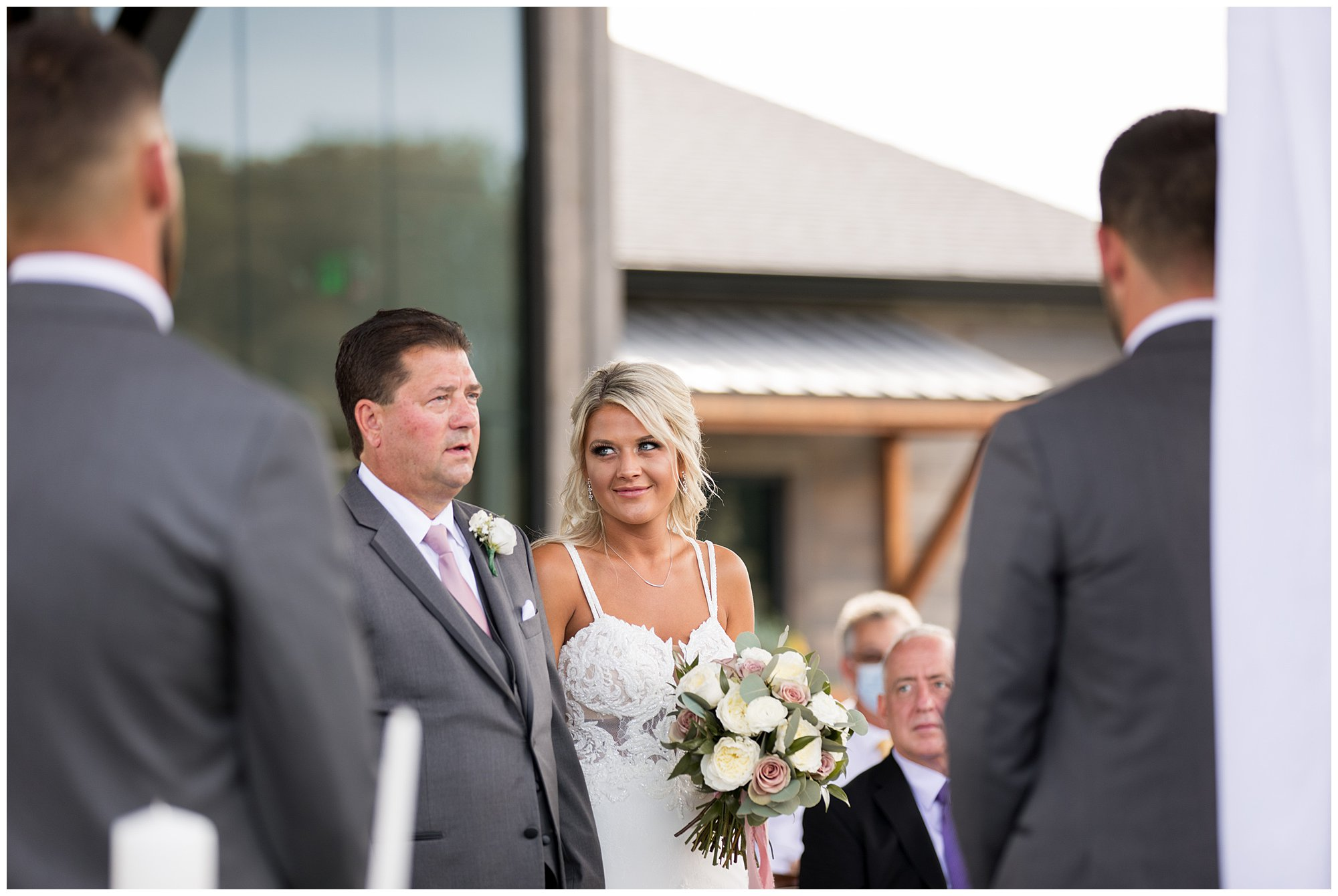 father gives bride away during Fort Wayne wedding at Union 12 venue