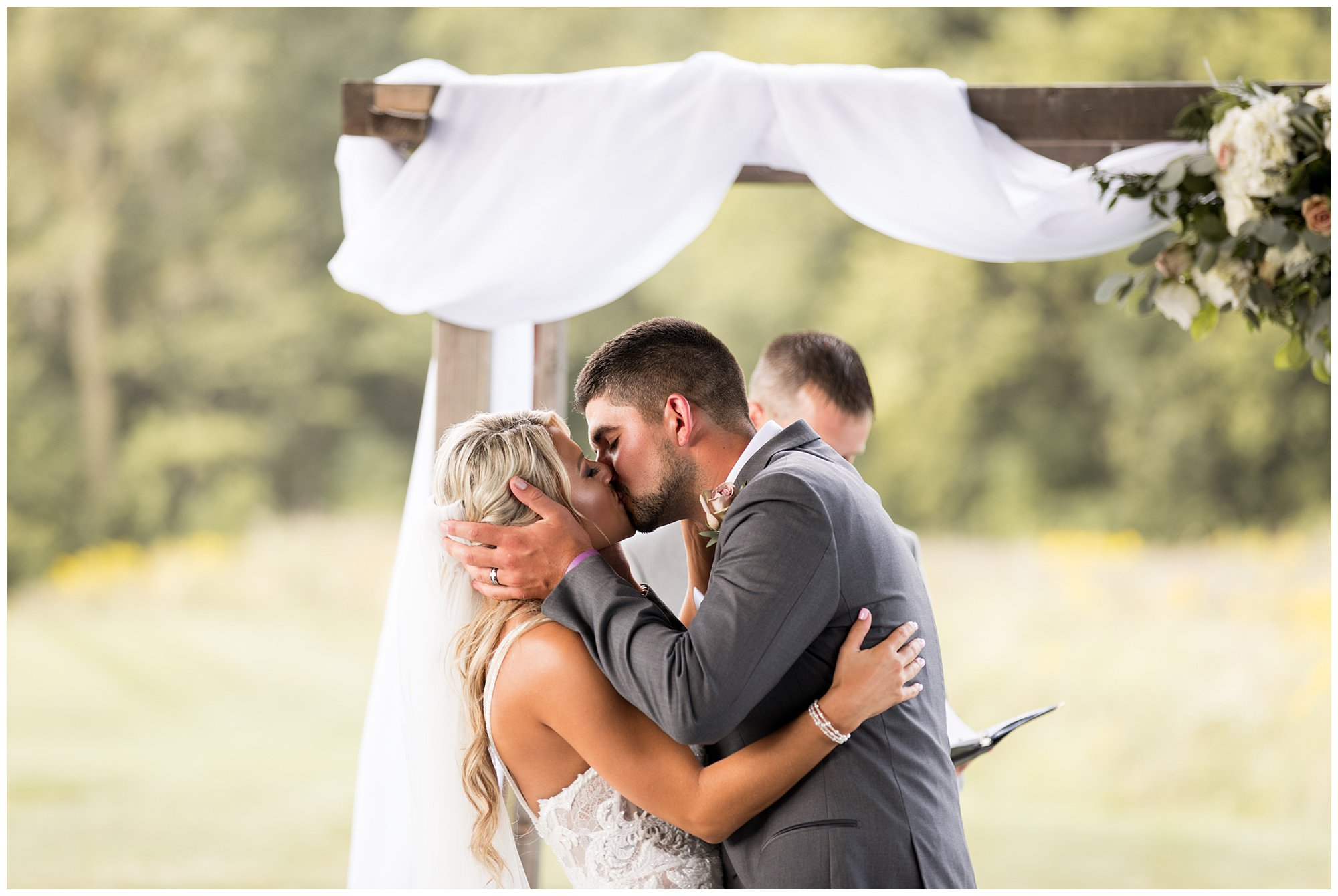 bride and groom first kiss as husband and wife at Union 12 wedding venue