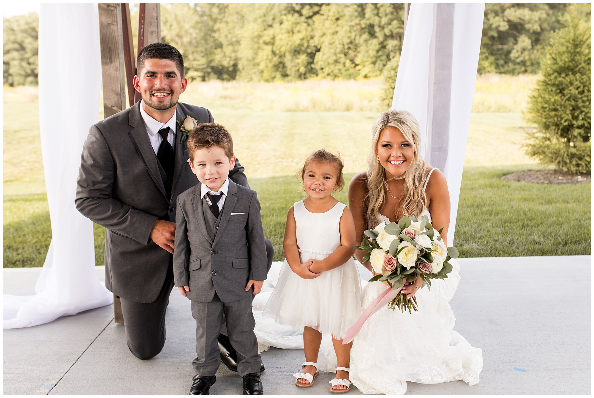 bride and groom with ring bearer and flower girl at Union 12