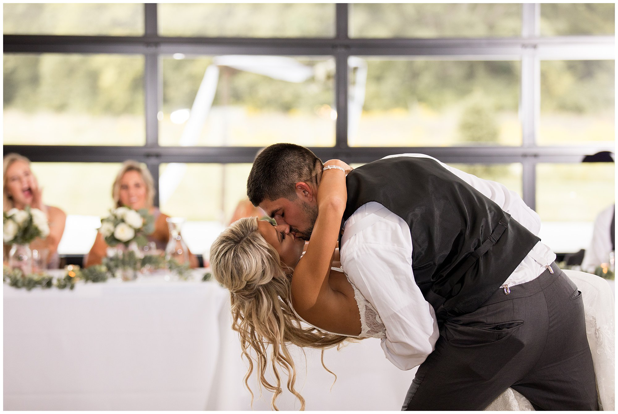 groom dips bride at end of first dance at Union 12 wedding reception