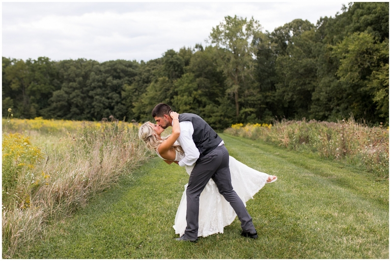 groom dips bride while kissing at Union 12 wedding