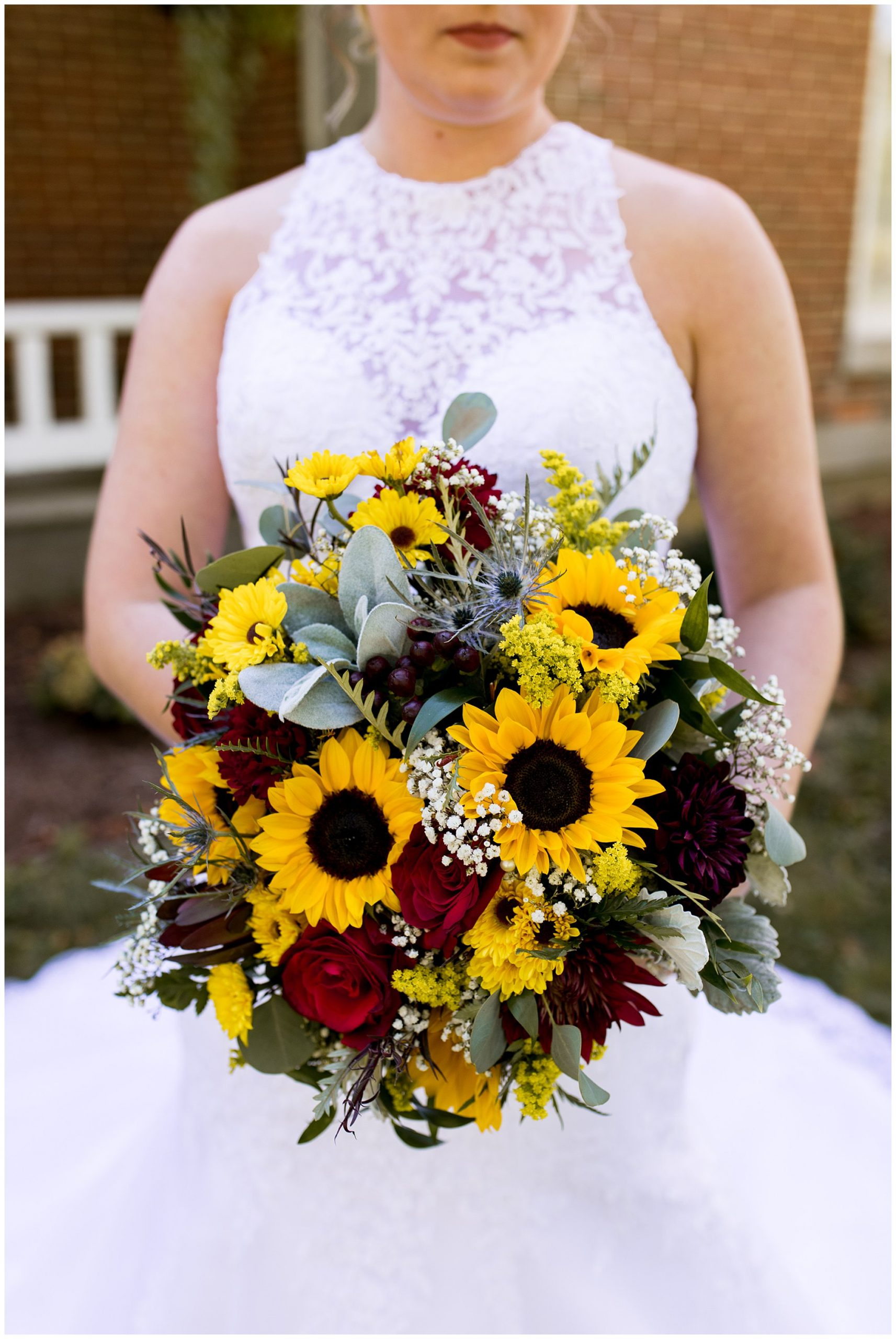 bride holding wedding bouquet from Jefferson House of Flowers in Kokomo Indiana