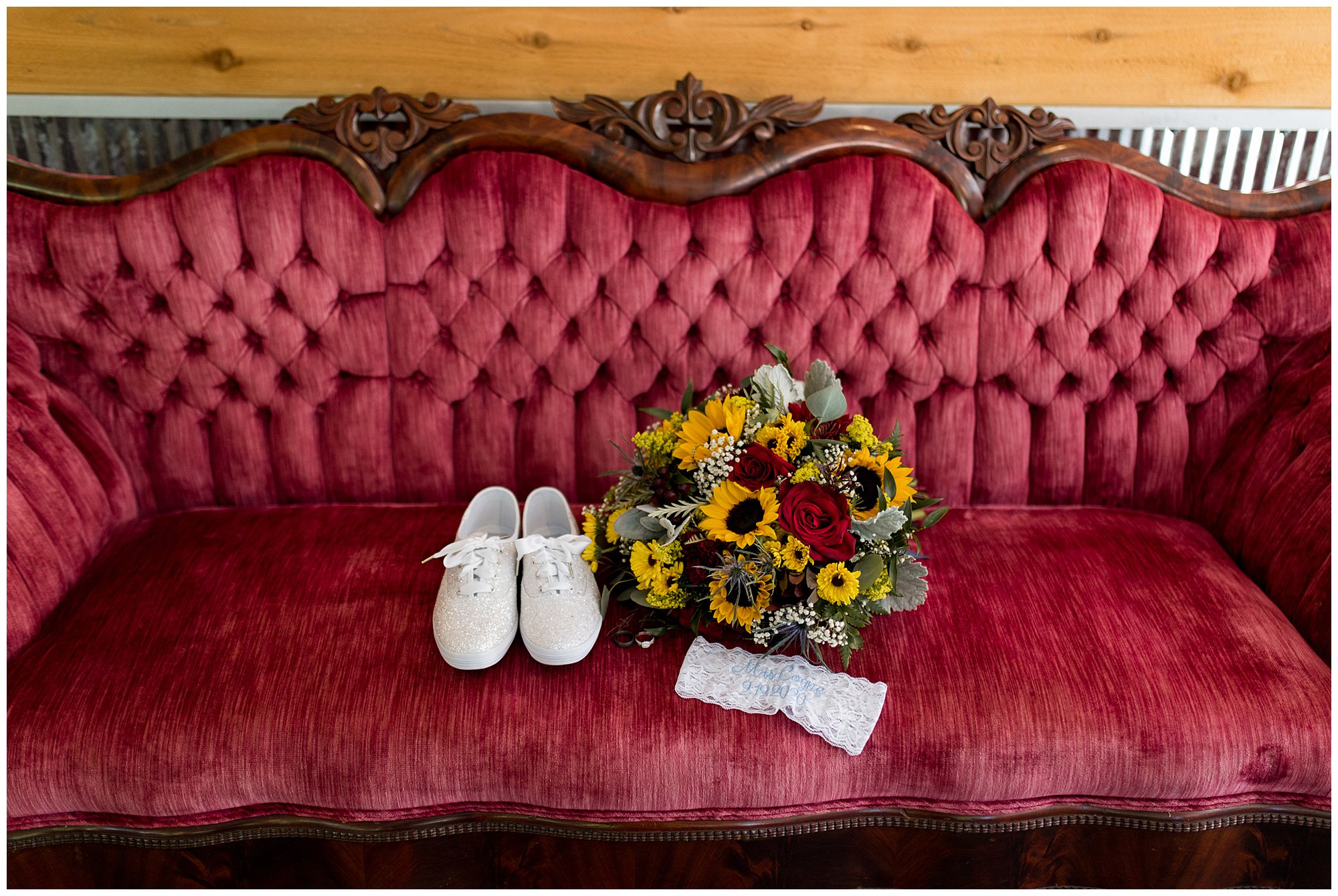 bride's wedding details on vintage couch at Legacy Barn in Kokomo