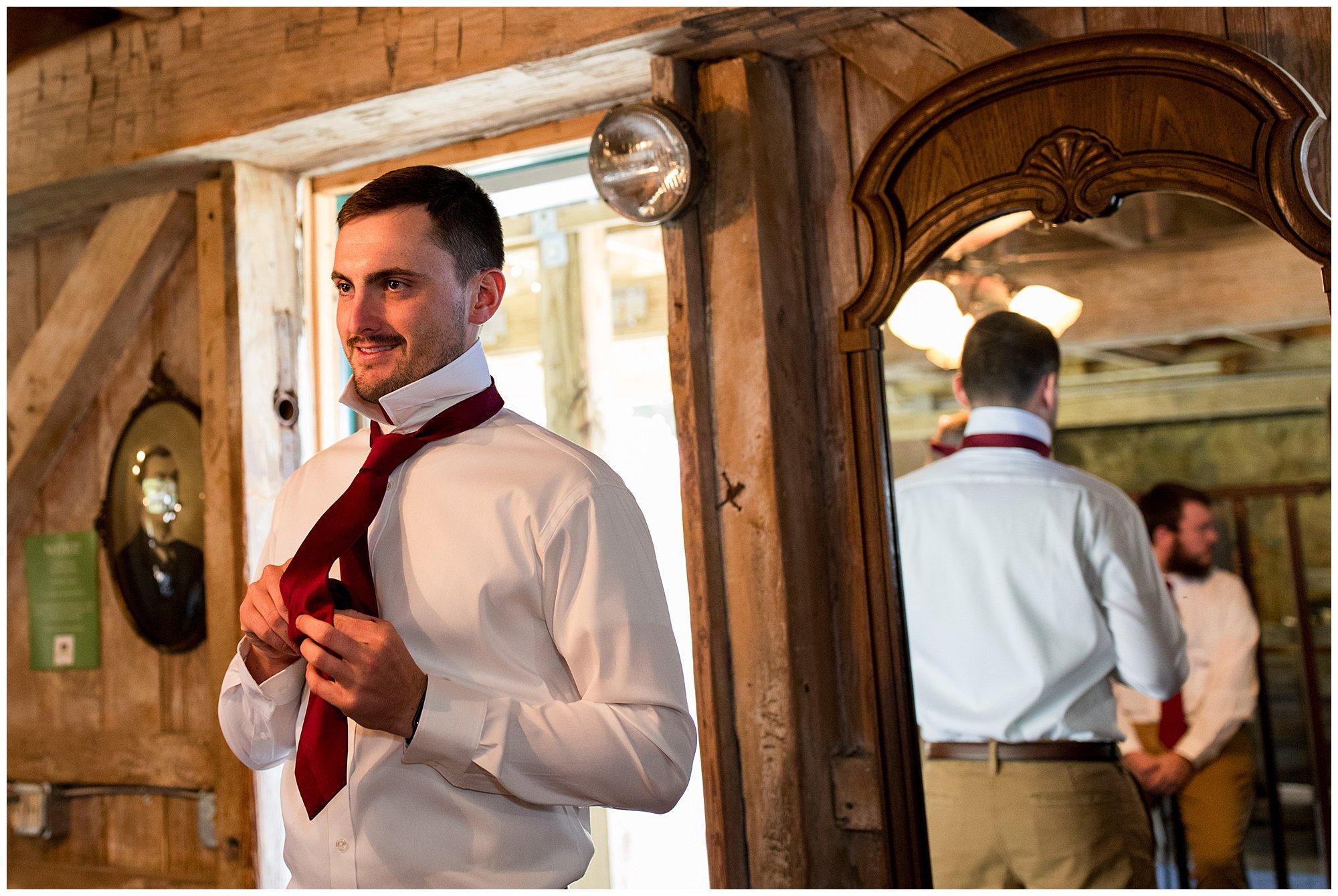 groom getting ready for wedding at Legacy Barn in Kokomo
