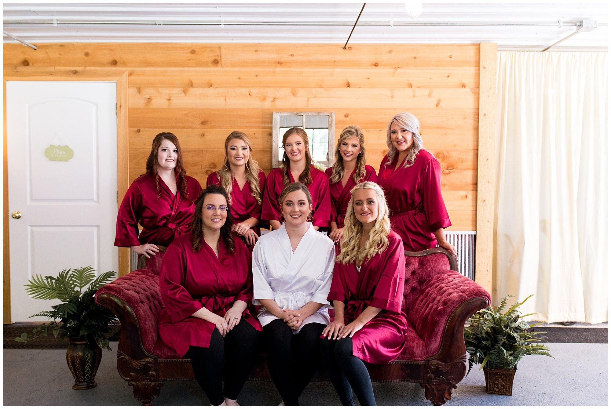 bride and bridesmaids in robes before wedding at Legacy Barn in Kokomo Indiana