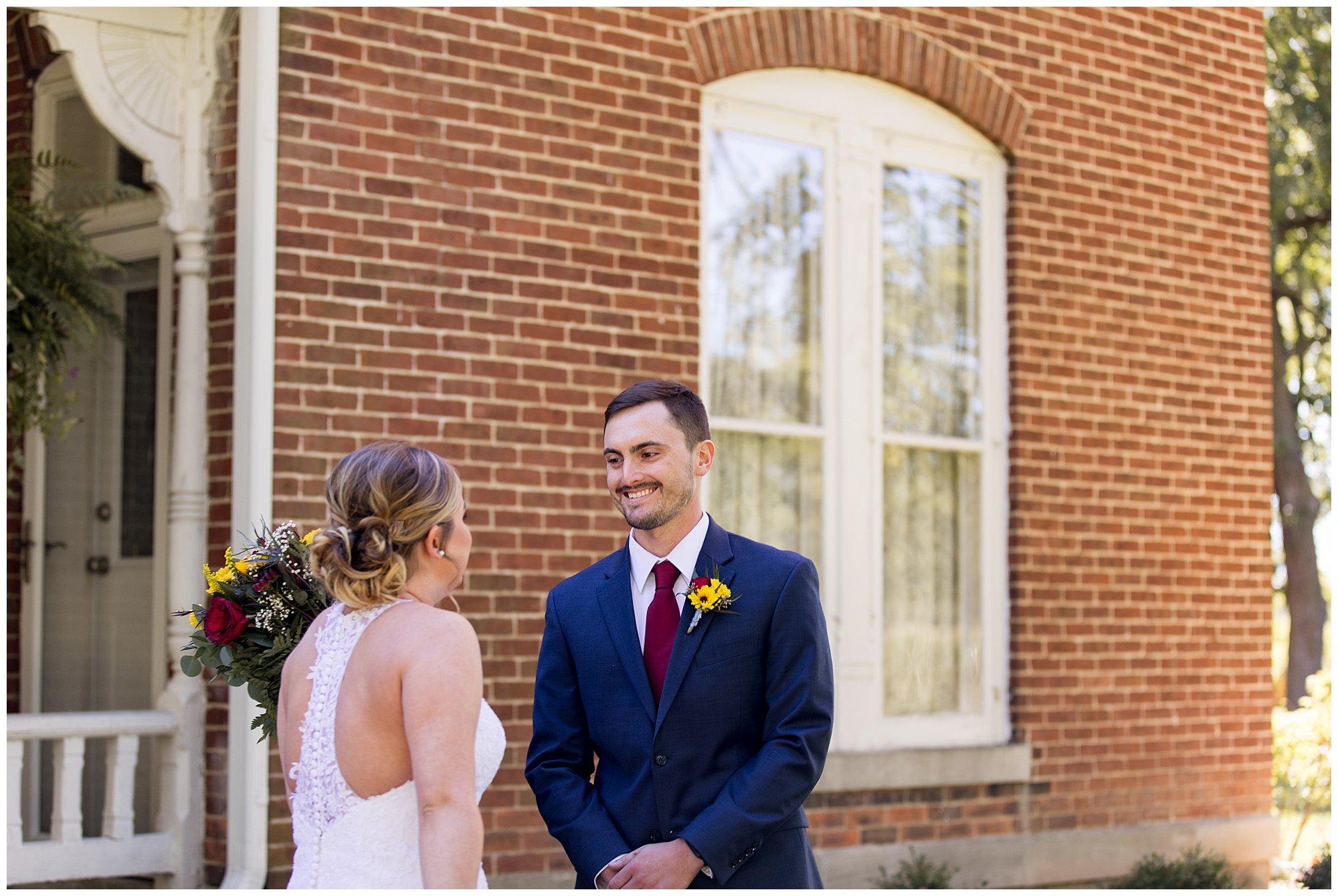 bride and groom first look before rustic Legacy Barn wedding in Kokomo Indiana