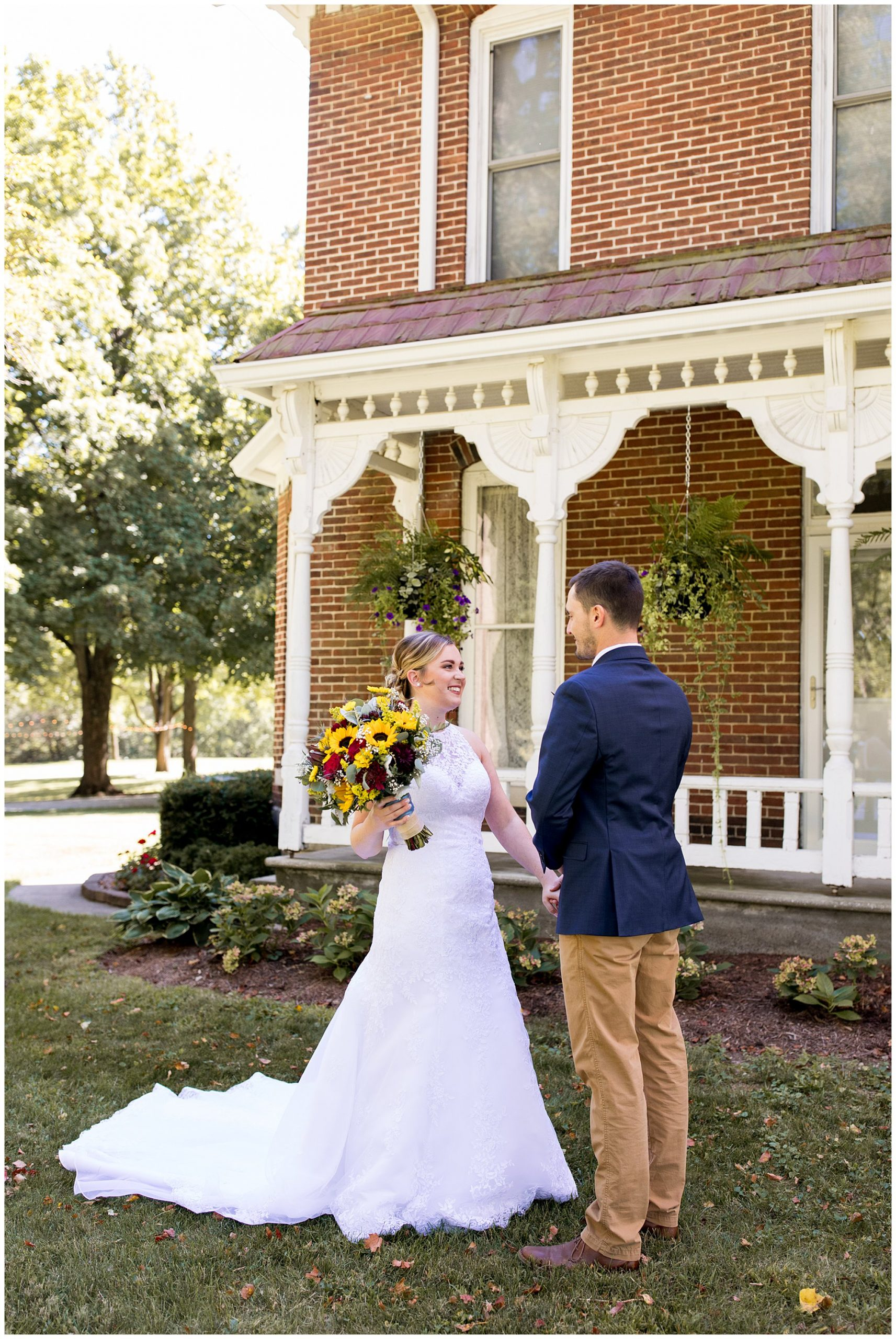 bride and groom have first look at Legacy Barn wedding venue in Kokomo Indiana