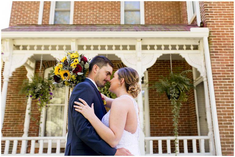bride and groom kiss before wedding at Legacy Barn in Kokomo
