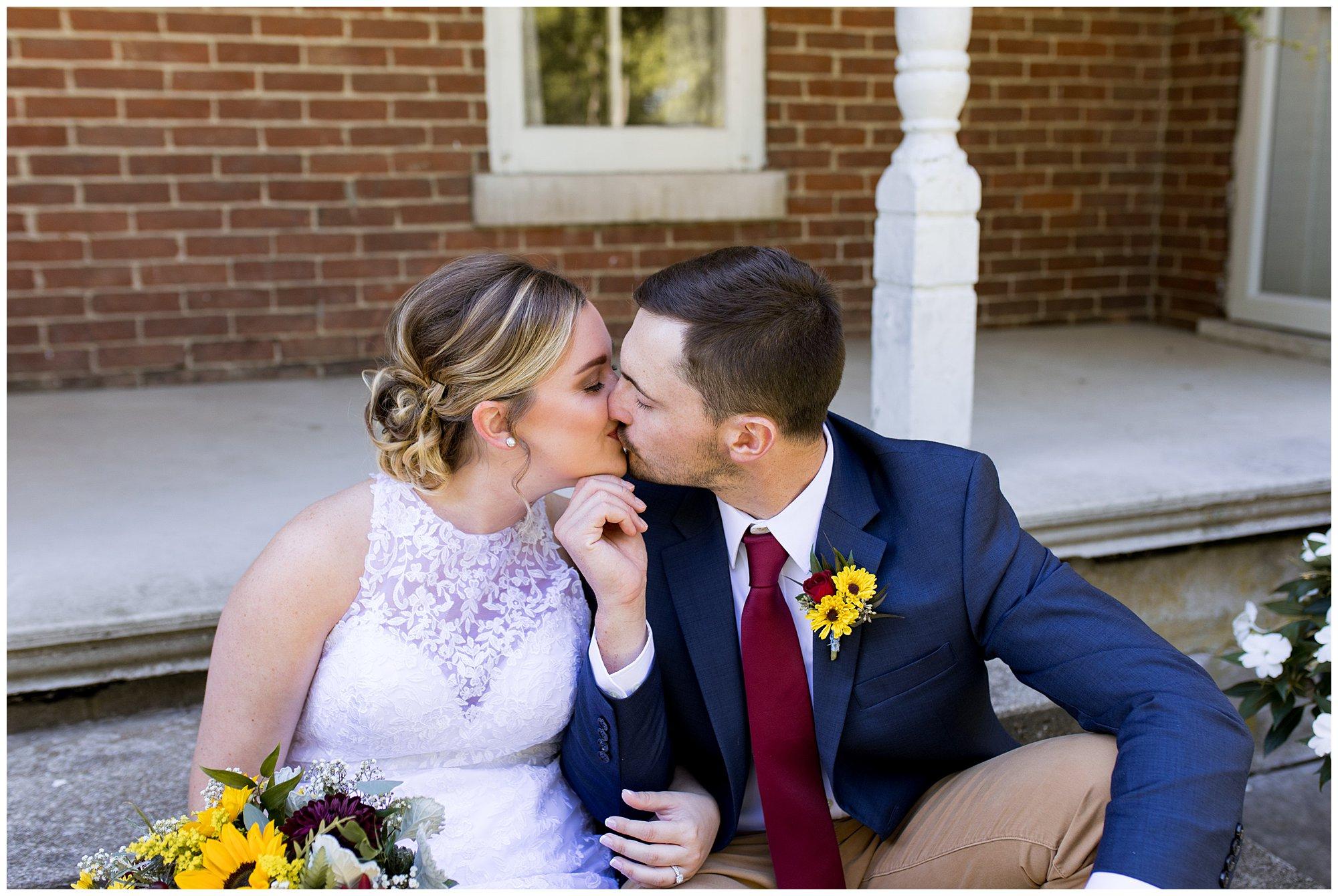 bride and groom kiss at Legacy Barn wedding venue in Kokomo Indiana