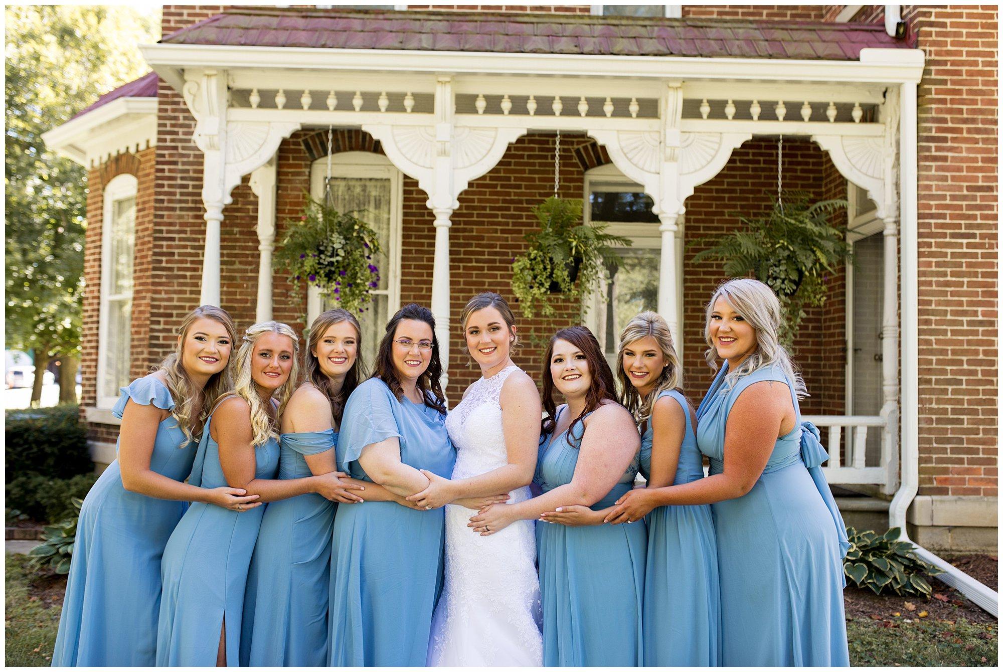 bride and bridesmaids photos before wedding ceremony at Legacy Barn in Kokomo