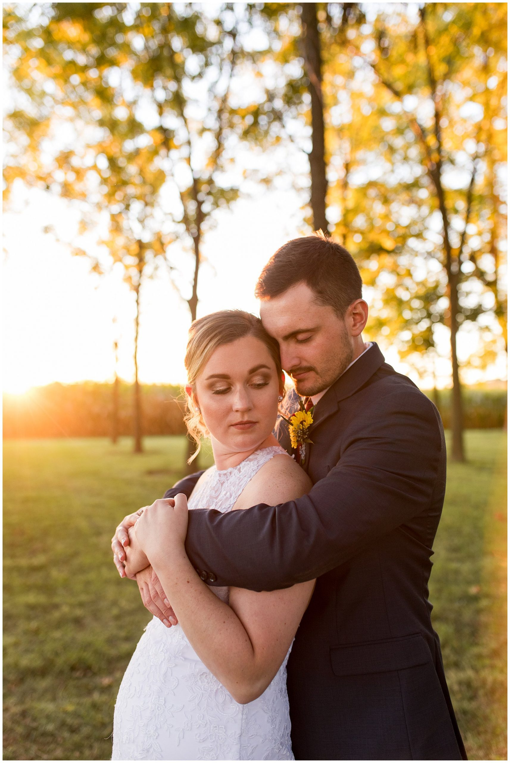 bride and groom wedding photos at sunset at Legacy Barn Kokomo