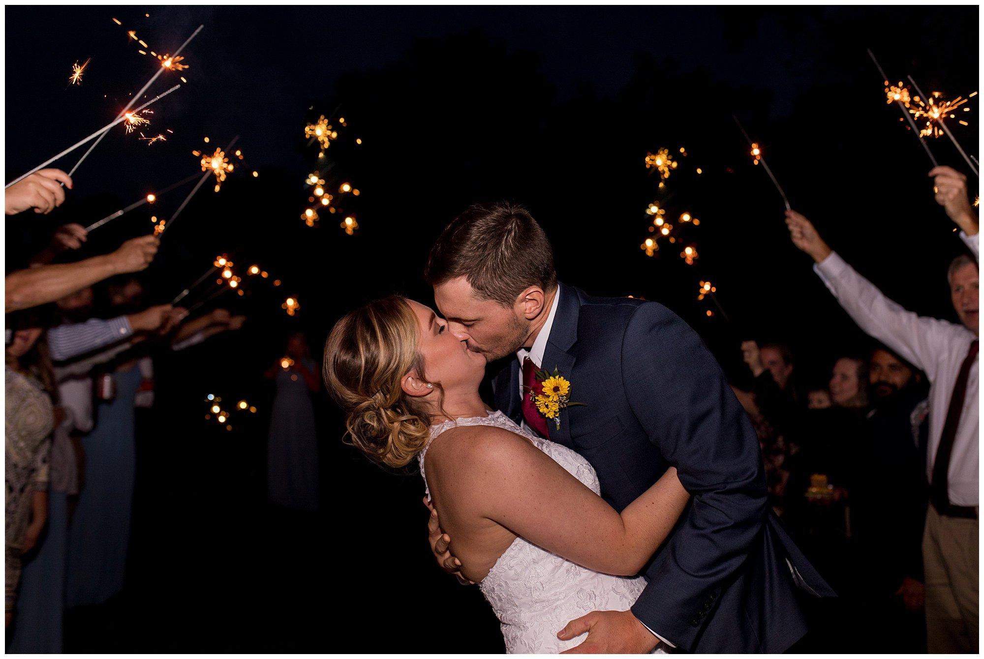 bride and groom sparkler exit at Kokomo Legacy Barn wedding venue
