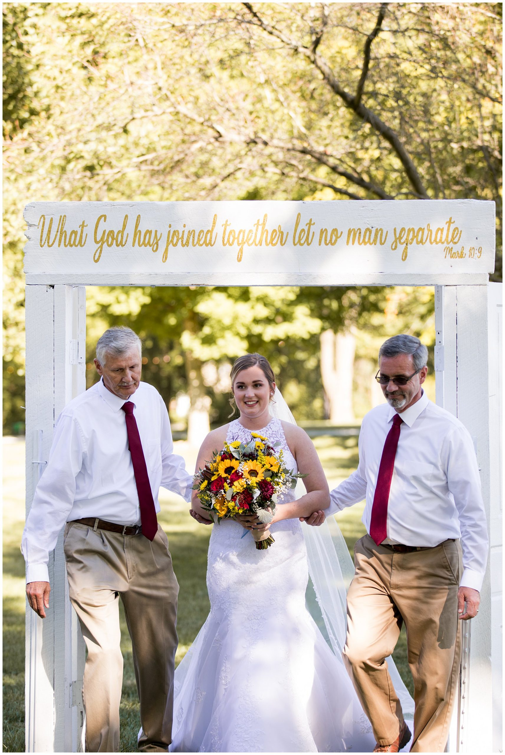 bride and fathers enter wedding ceremony at Legacy Barn in Kokomo Indiana