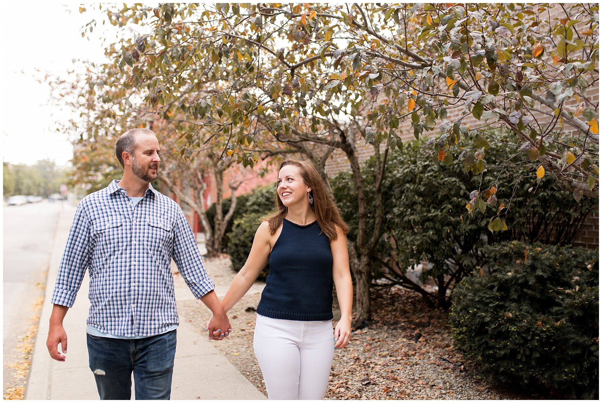 bride and groom walk hand in hand during engagement session in Indianapolis