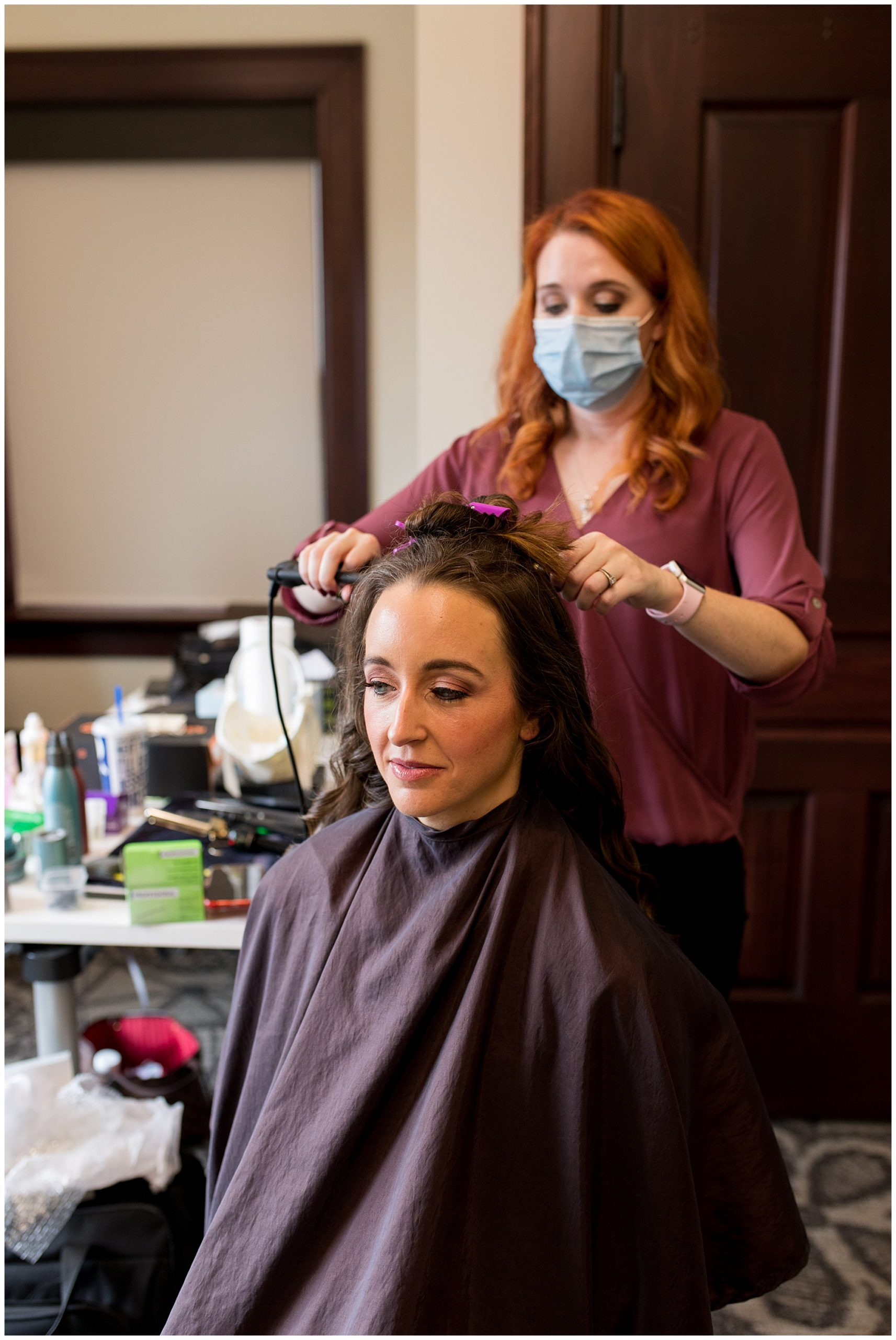 bride gets hair done by The Red Stiletto before Eagles Theatre wedding