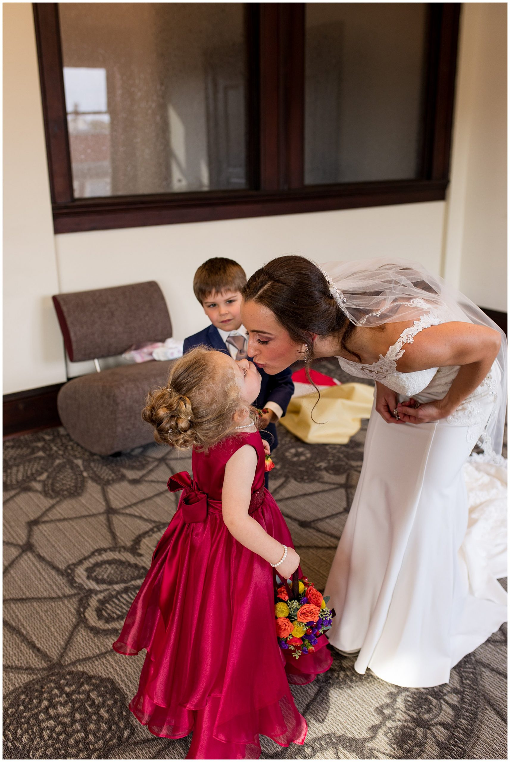 bride gives daughter a kiss before Eagles Theatre wedding in Wabash