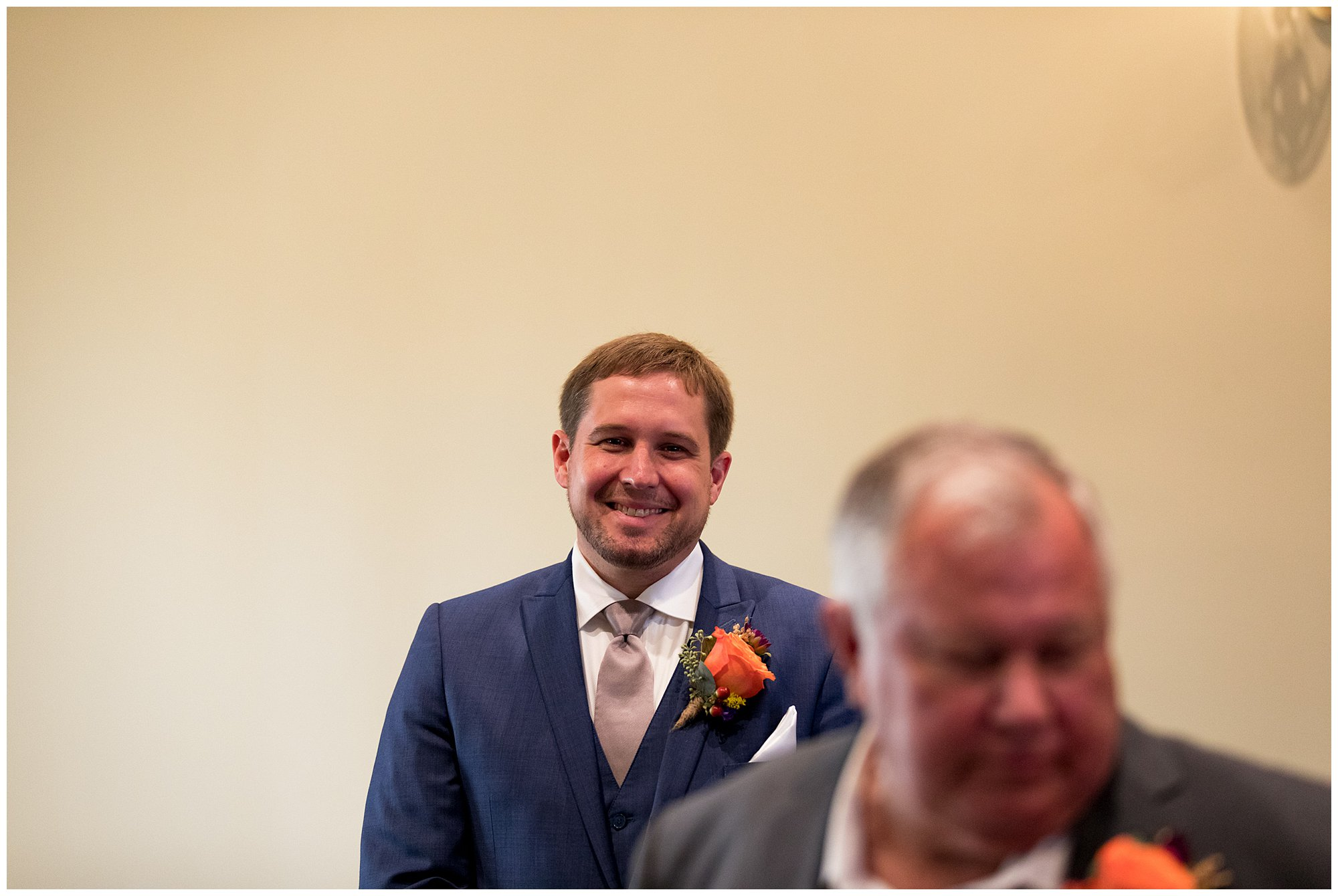 groom awaits bride's walk down aisle in Parkview Ballroom at Eagles Theatre