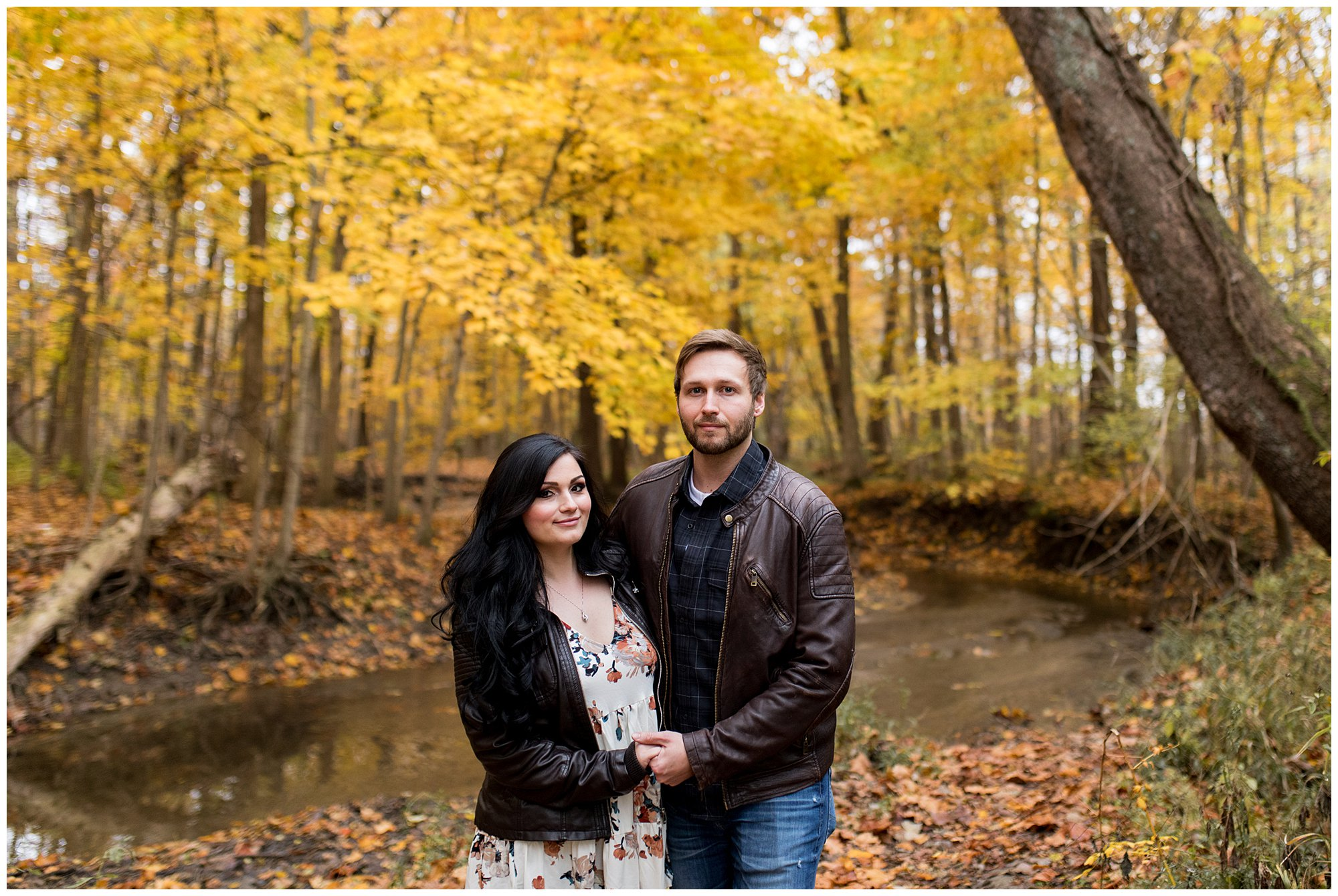 couple holds hands during Kokomo engagement session at Jackson Morrow Park