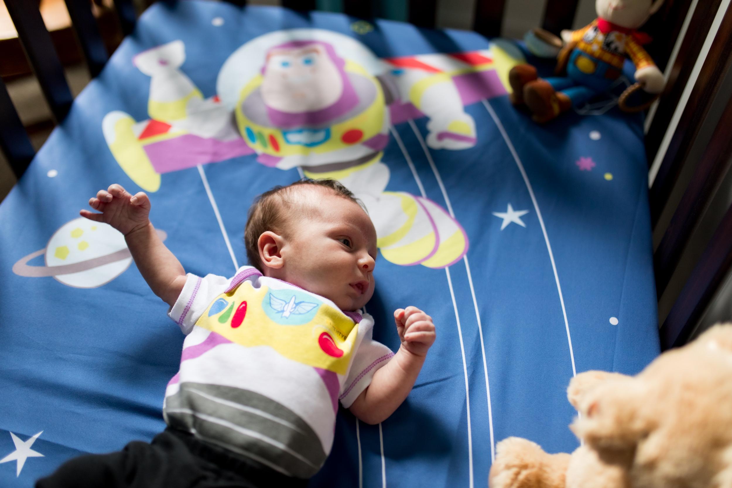 baby lies in crib during Kokomo newborn session