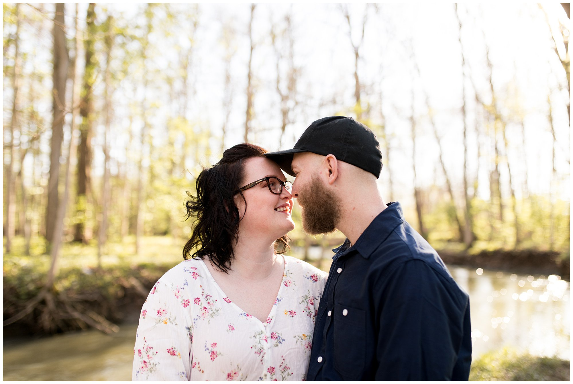 couple touches noses during engagement session in Kokomo